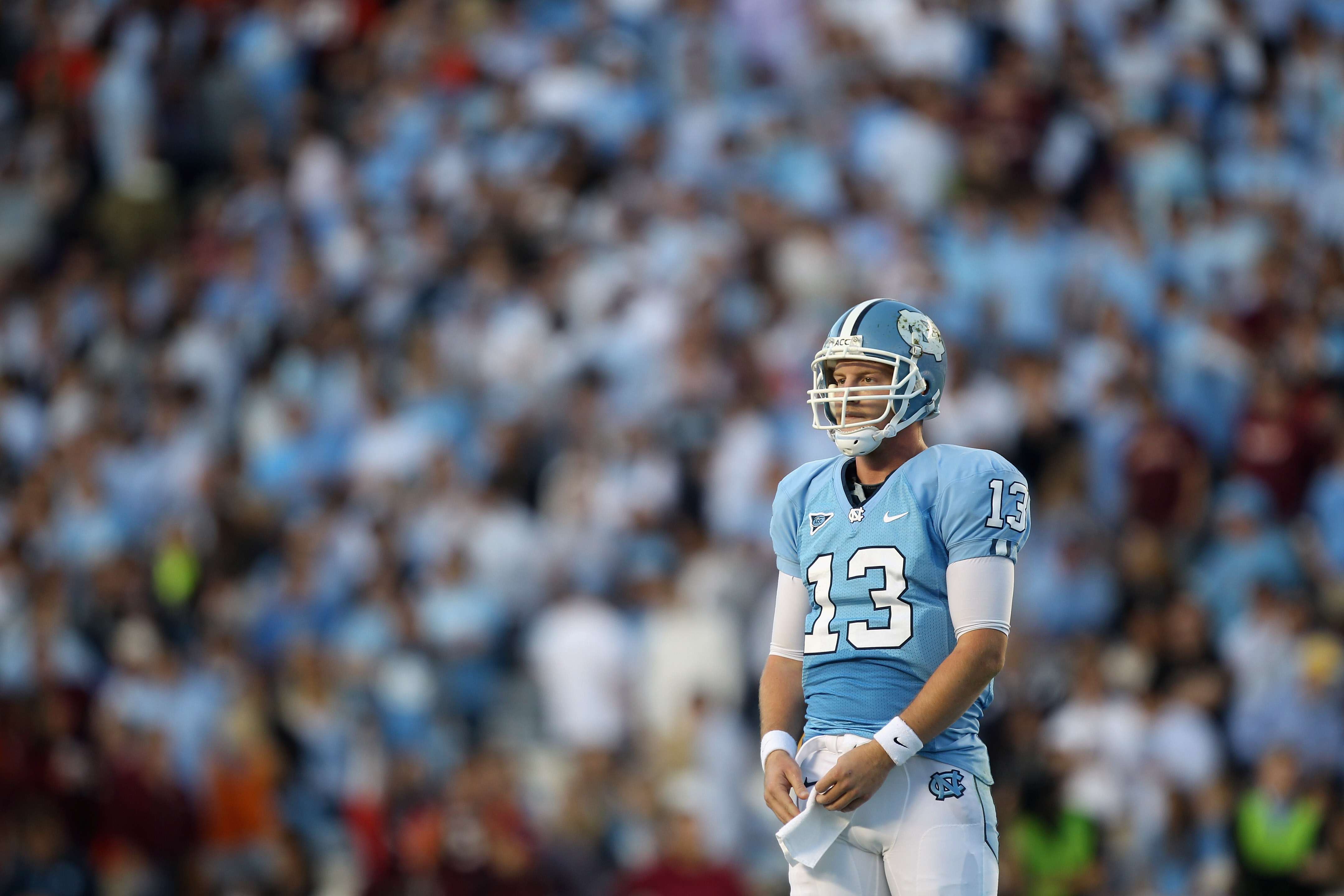 CHAPEL HILL, NC - NOVEMBER 13:  T.J. Yates #13 of the North Carolina Tar Heels waits for a play from the sidelines against the Virginia Tech Hokies during their game at Kenan Stadium on November 13, 2010 in Chapel Hill, North Carolina.  (Photo by Streeter
