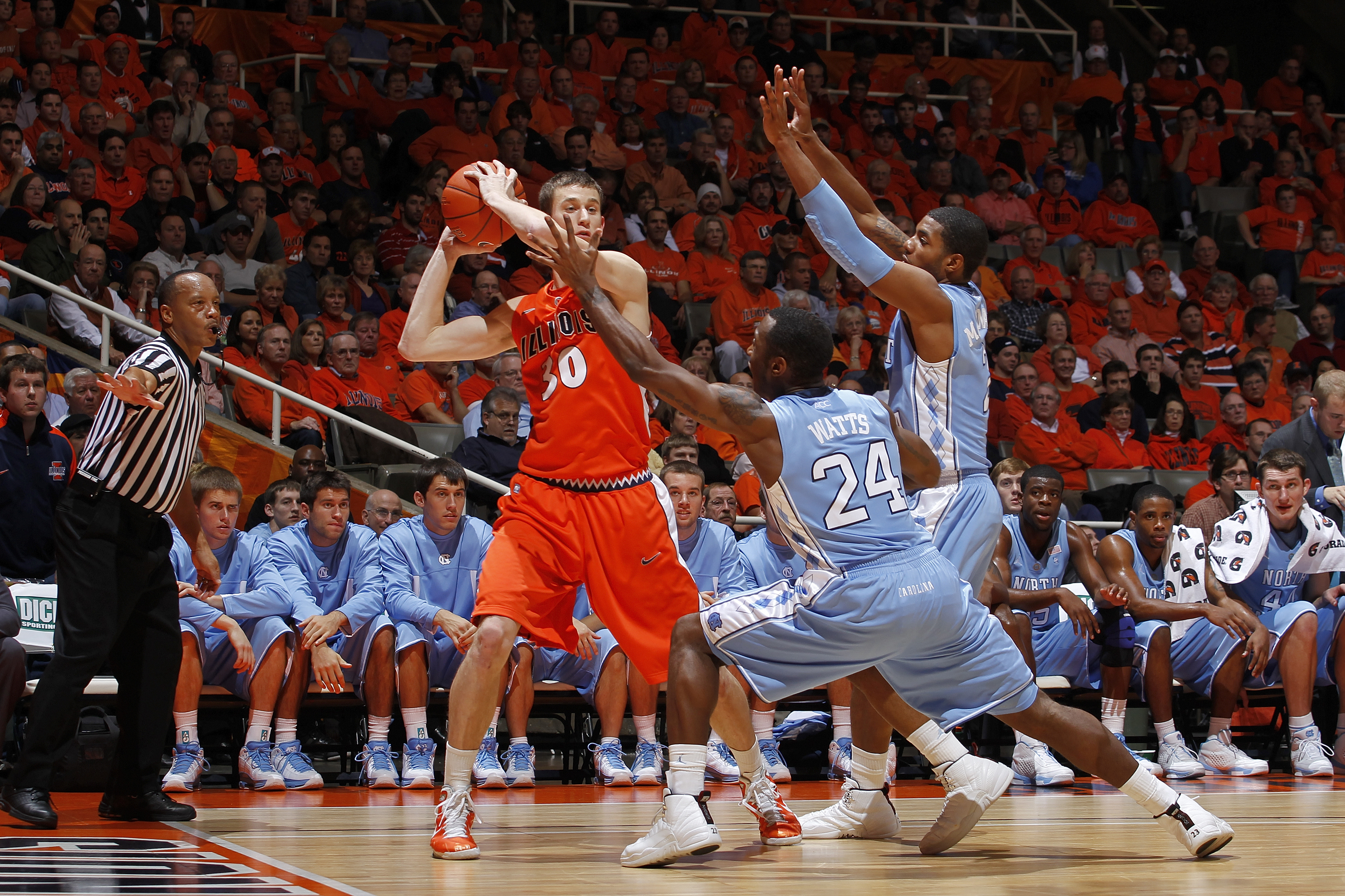 CHAMPAIGN, IL - NOVEMBER 30: Justin Watts #24 and Leslie McDonald #2 of the North Carolina Tar Heels defend against Bill Cole #30 of the Illinois Fighting Illini during the 2010 ACC/Big Ten Challenge at Assembly Hall on November 30, 2010 in Champaign, Ill