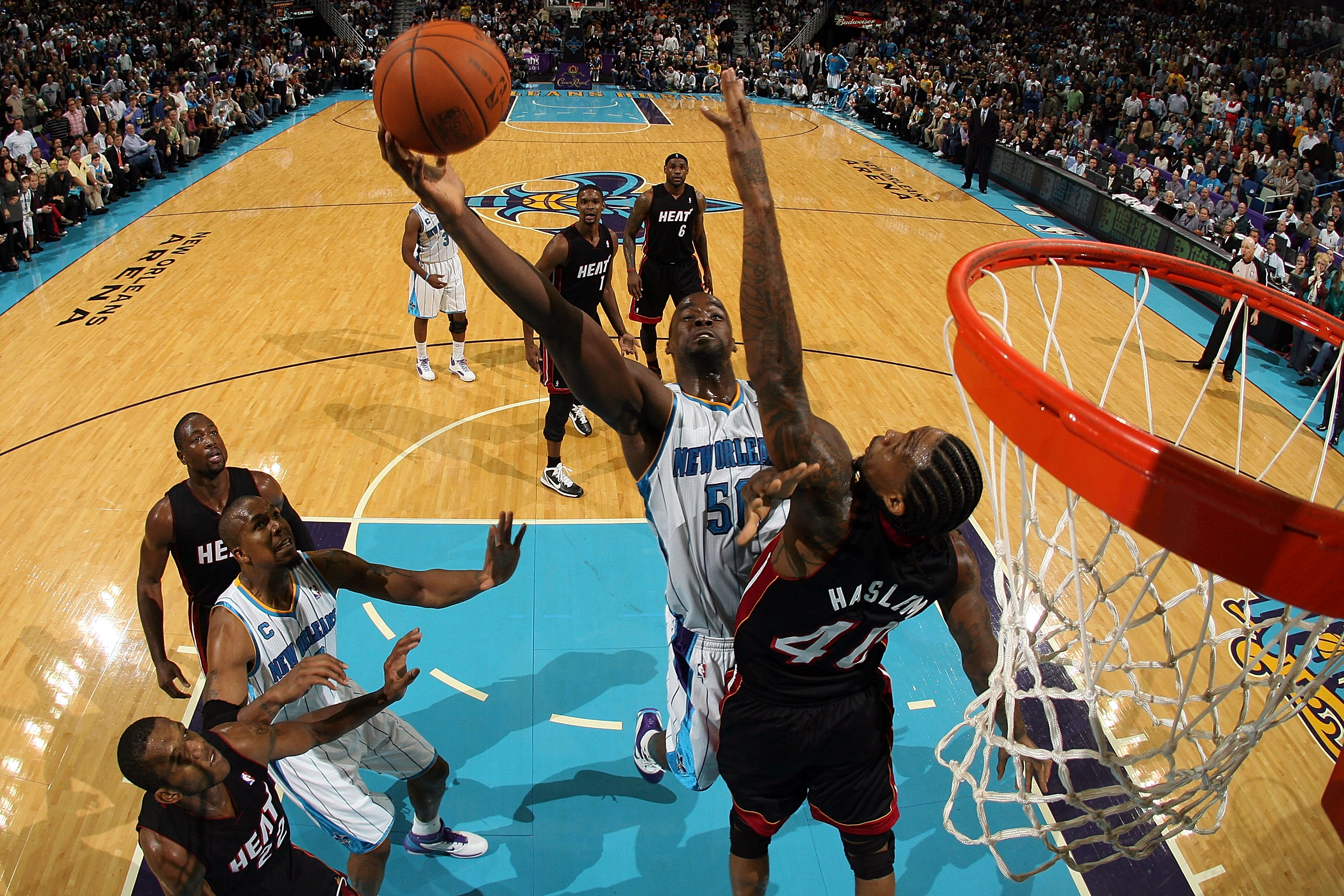 NEW ORLEANS - NOVEMBER 05:  Emeka  Okafor #50 of the New Orleans Hornets shoots the ball over Udonis Haslem #40 of the Miami Heat at the New Orleans Arena on November 5, 2010 in New Orleans, Louisiana.  The Hornets defeated the Heat 96-93.  NOTE TO USER: