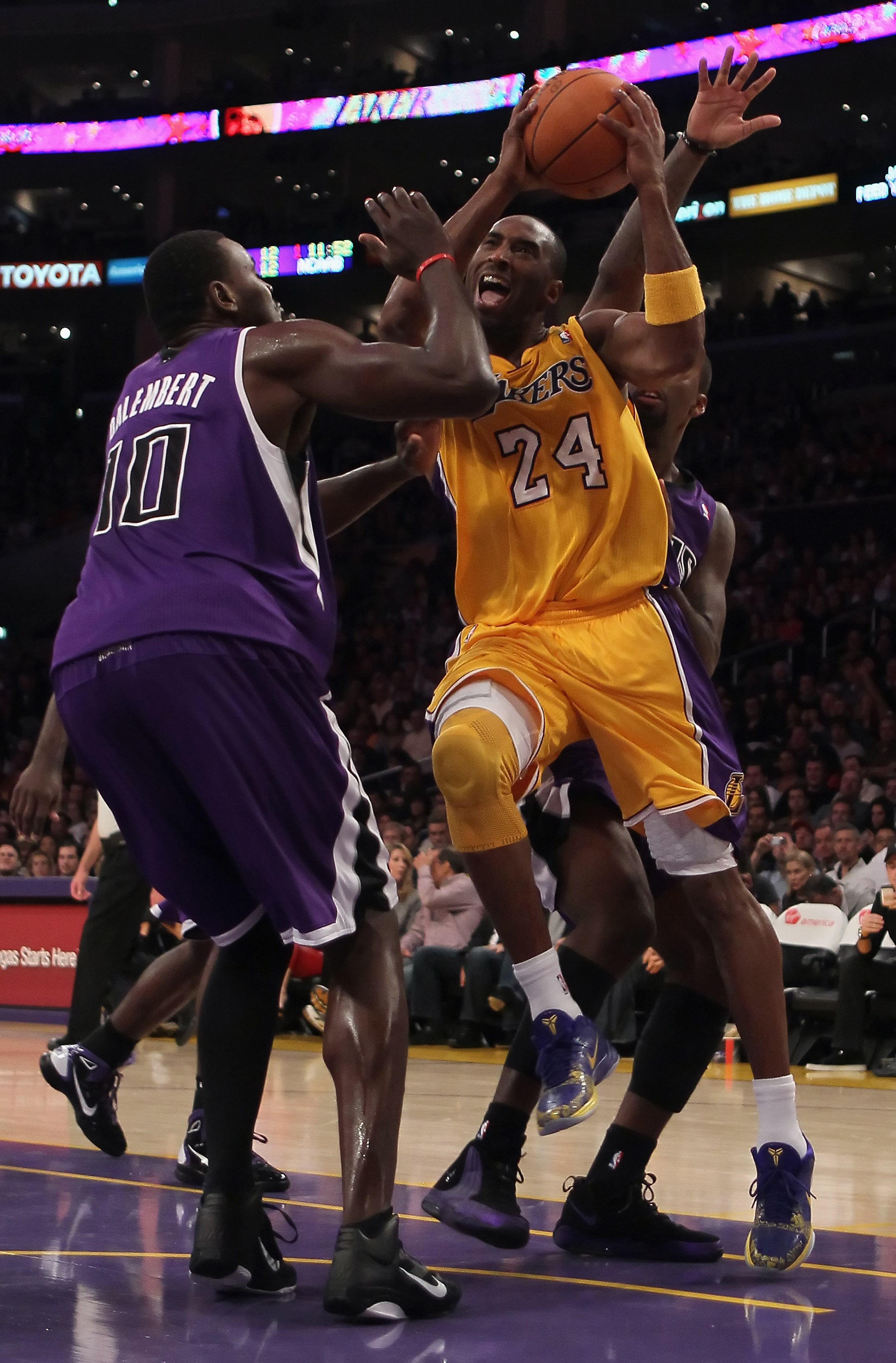 LOS ANGELES, CA - DECEMBER 03:  Kobe Bryant #24 of the Los Angeles Lakers drives to the basket while being defended by Samuel Dalembert #10 of the Sacramento Kings during the first half at Staples Center on December 3, 2010 in Los Angeles, California. The