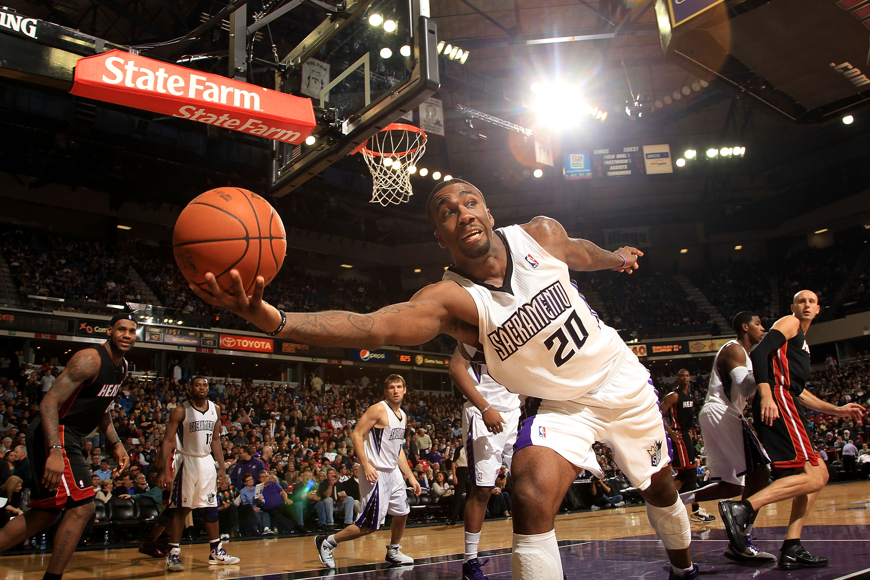 SACRAMENTO, CA - DECEMBER 11:  Donte Greene #20 the Sacramento Kings saves the ball from going out of bounds during their game against the Miami Heat at ARCO Arena on December 11, 2010 in Sacramento, California.  NOTE TO USER: User expressly acknowledges