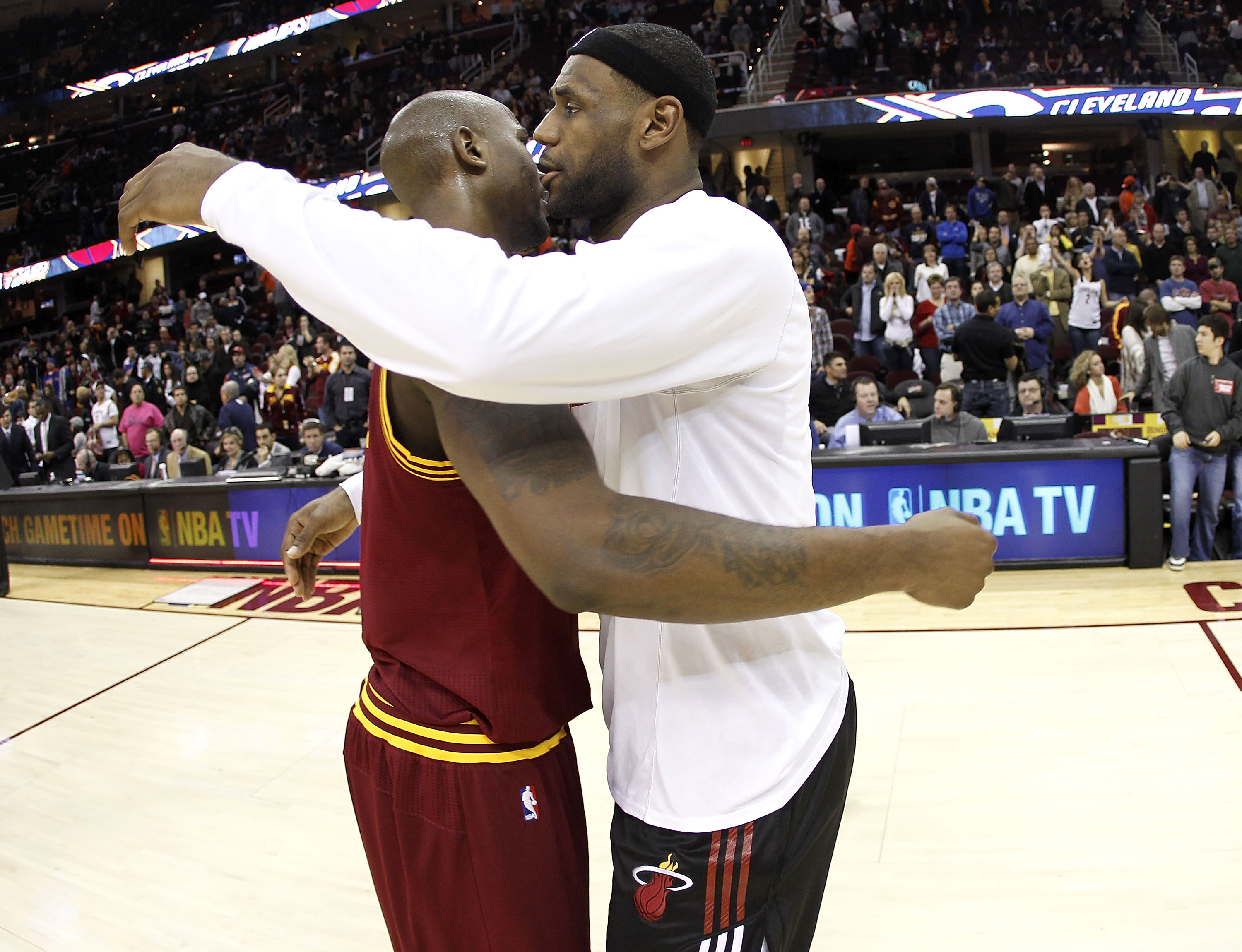 CLEVELAND, OH - DECEMBER 02:  LeBron James #6 of the Miami Heat hugs Jawad Williams after a 118-90 victory over the Cleveland Cavaliers at Quicken Loans Arena on December 2, 2010 in Cleveland, Ohio. NOTE TO USER: User expressly acknowledges and agrees tha