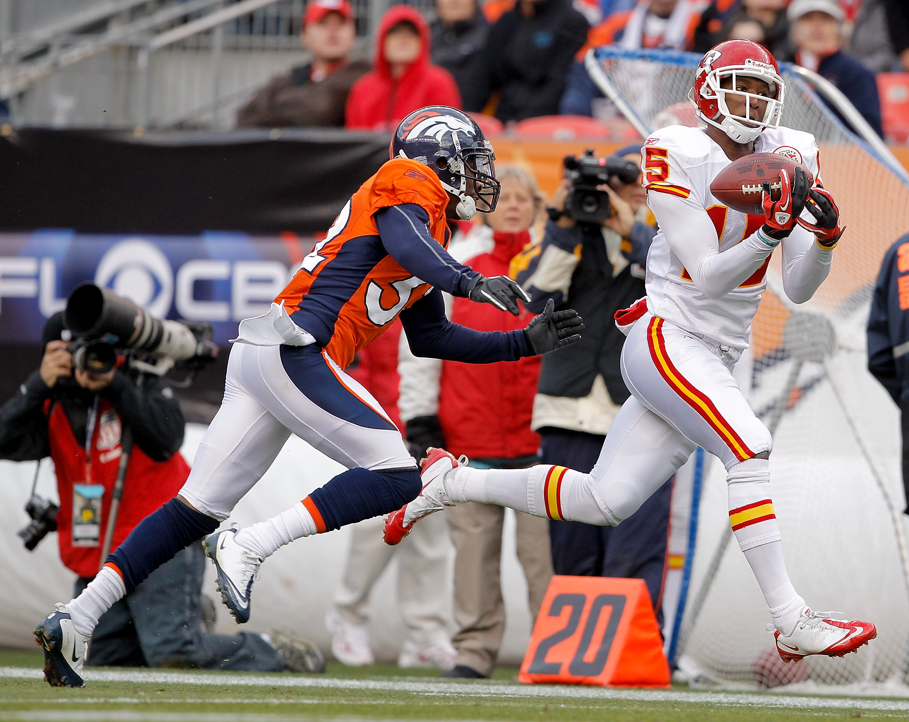 DENVER - NOVEMBER 14:  Wide receiver Verran Tucker #15 of the Kansas City Chiefs makes a reception against cornerback Perrish Cox #32 of the Denver Broncos during the second quarter at INVESCO Field at Mile High on November 14, 2010 in Denver, Colorado. (