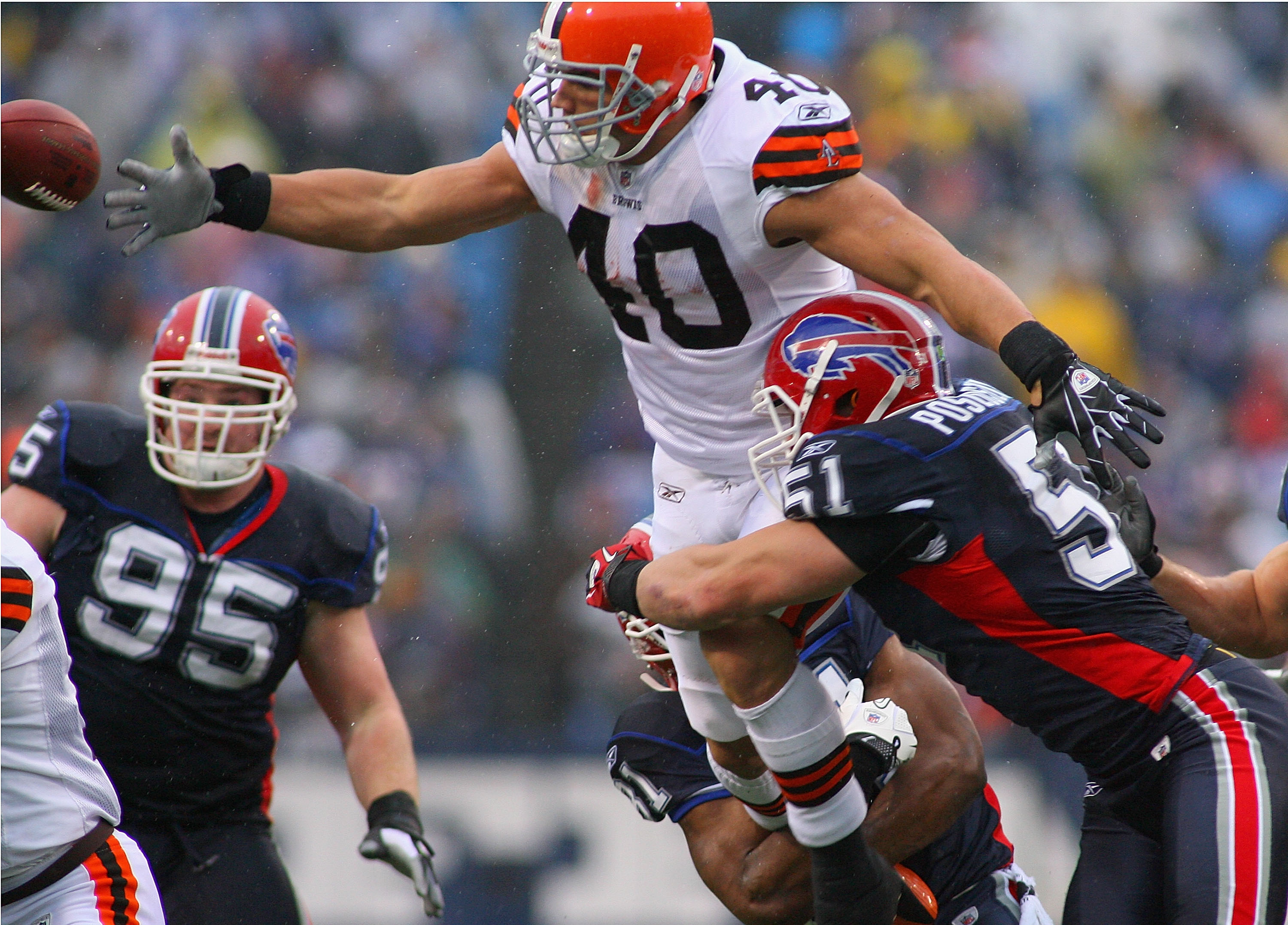 ORCHARD PARK, NY - DECEMBER 12:  Peyton Hillis #40 of the Cleveland Browns fumbles as he tries to jump over Paul Posluszny #51 of the Buffalo Bills at Ralph Wilson Stadium on December 12, 2010 in Orchard Park, New York. Buffalo won 13-6.  (Photo by Rick S