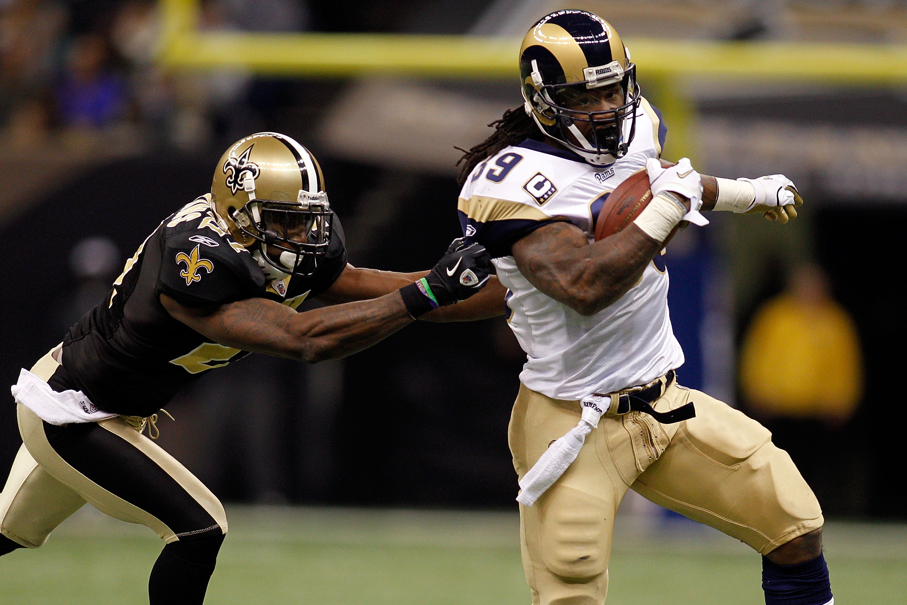 NEW ORLEANS, LA - DECEMBER 12:  Steven Jackson #39 of the St. Louis Rams is tackled by Malcom Jenkins #27 of the New Orleans Saints at the Louisiana Superdome on December 12, 2010 in New Orleans, Louisiana.  (Photo by Chris Graythen/Getty Images)