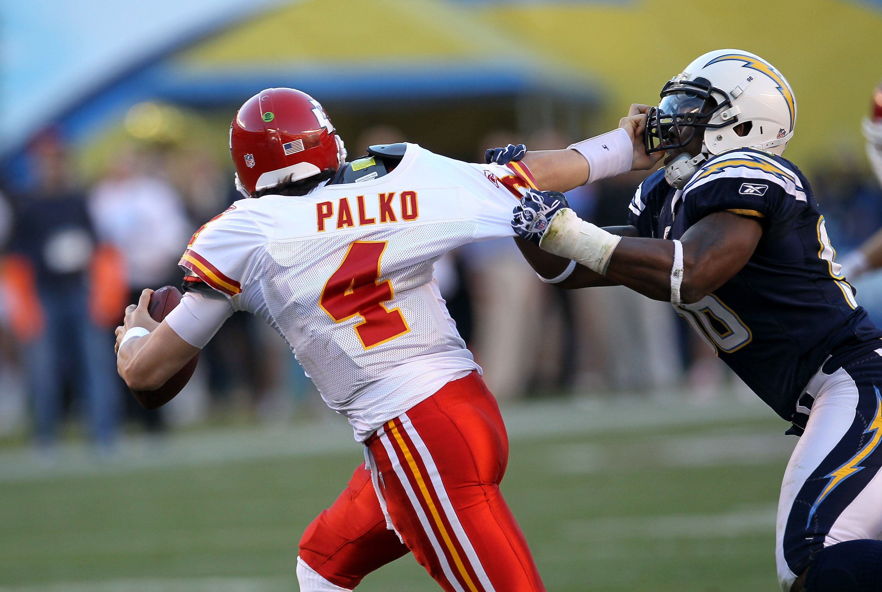 SAN DIEGO - DECEMBER 12:  Quarterback Tyler Palko #4 of the Kansas City Chiefs tries to fend off linebacker Antwan Barnes #98 of the San Diego Chargers at Qualcomm Stadium on December 12, 2010 in San Diego, California.  The Chargers won 31-0.  (Photo by S