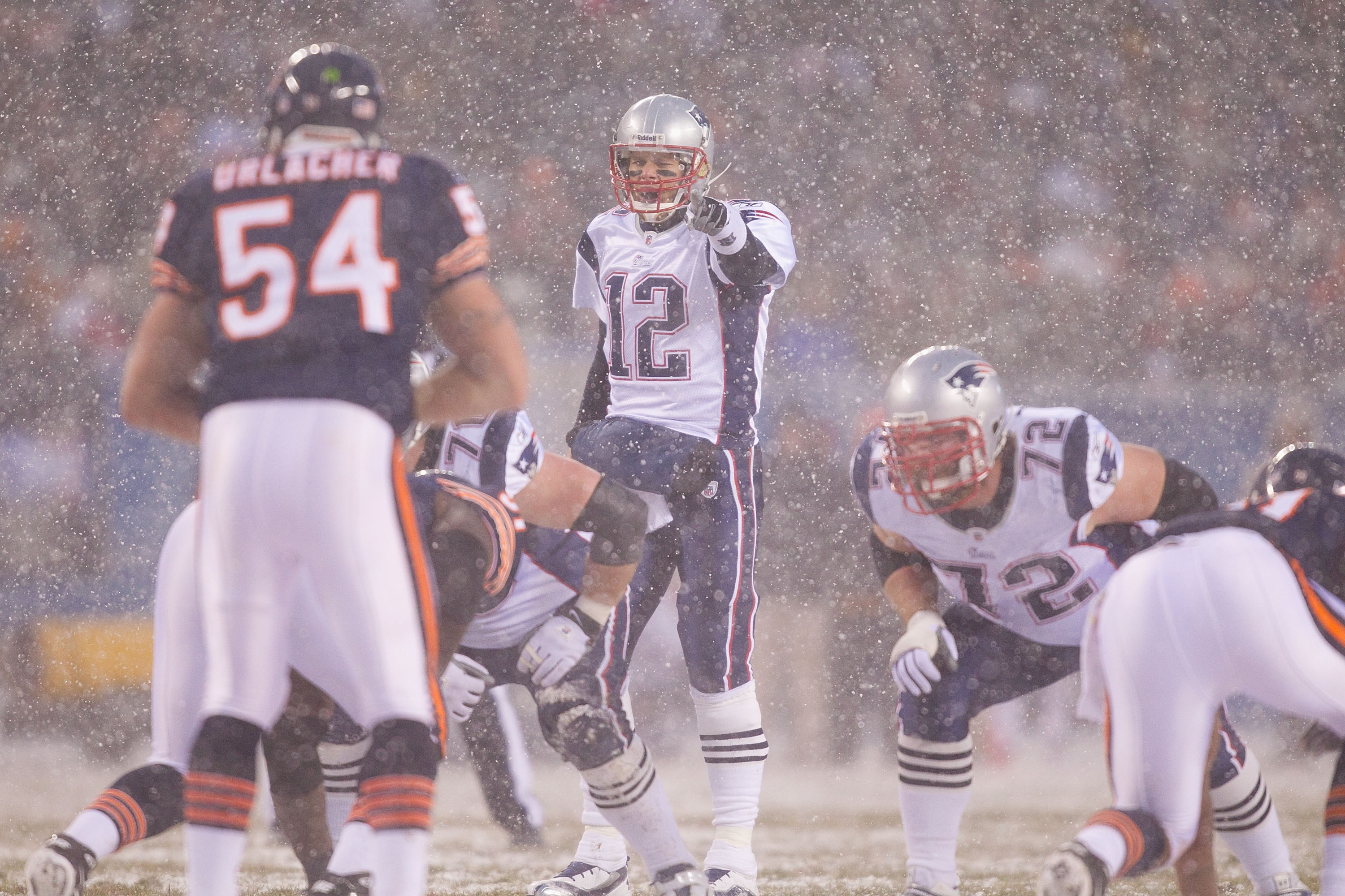 CHICAGO, IL - DECEMBER 12: Tom Brady #12 of the New England Patriots directs the offense against the Chicago Bears at Soldier Field on December 12, 2010 in Chicago, Illinois.  The Patriots beat the Bears 36-7.  (Photo by Dilip Vishwanat/Getty Images)