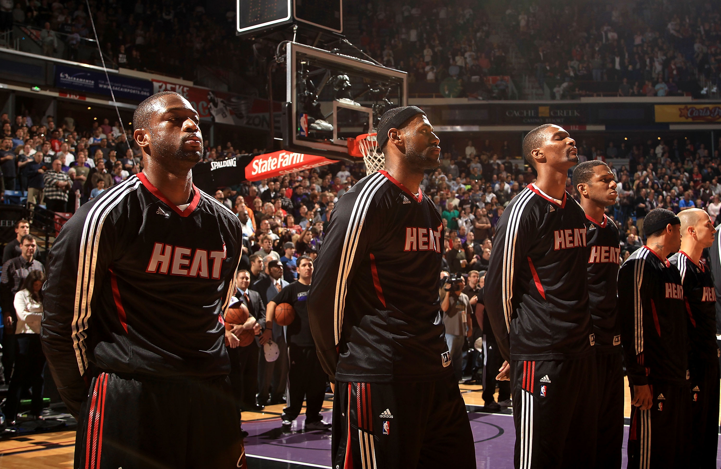 SACRAMENTO, CA - DECEMBER 11:  Dwayne Wade #3, Lebron James #6 and Chris Bosh #1 of the Miami Heat stand for the National Anthem before their game against the Sacramento Kings at ARCO Arena on December 11, 2010 in Sacramento, California.  NOTE TO USER: Us