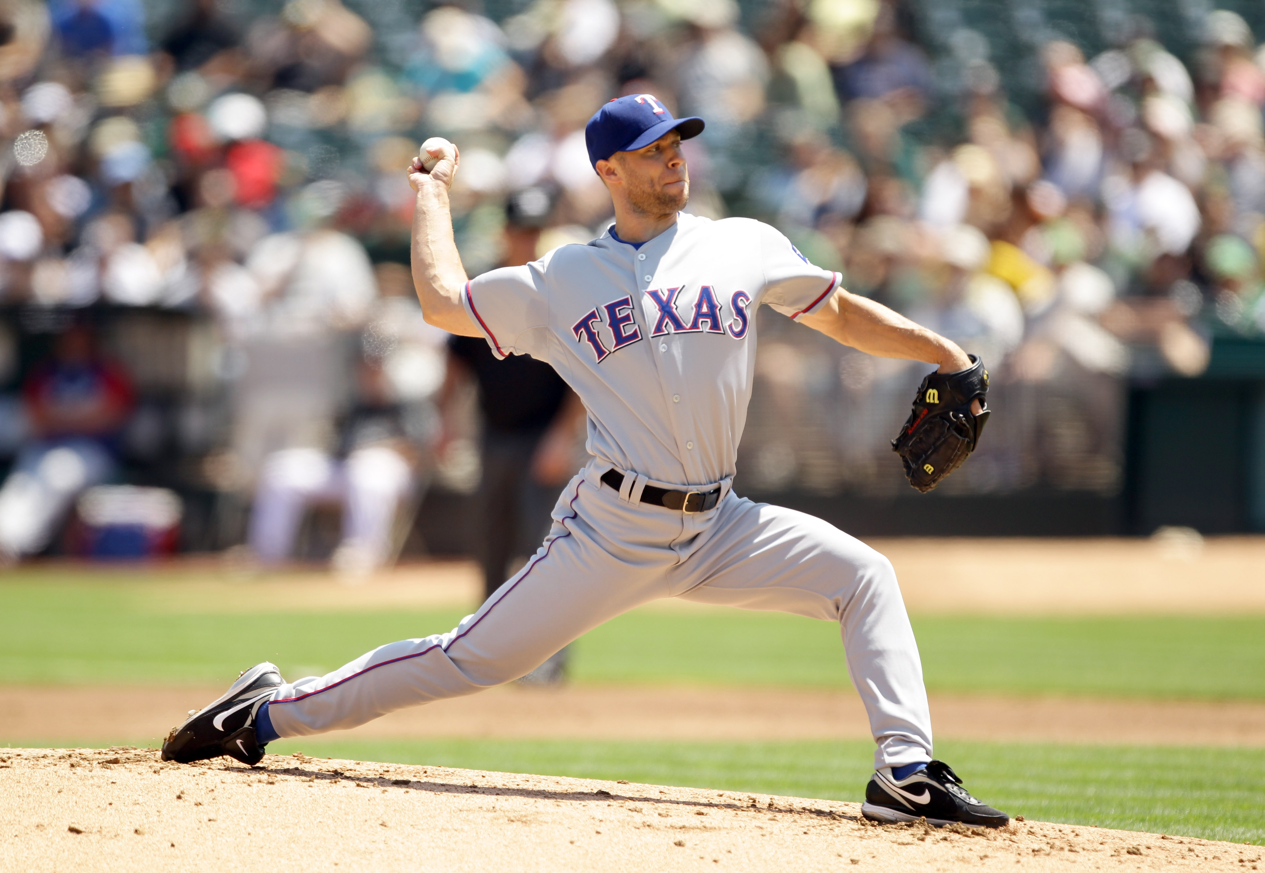 OAKLAND, CA - AUGUST 07:  Rich Harden #40 of the Texas Rangers pitches against the Oakland Athletics at the Oakland-Alameda County Coliseum on August 7, 2010 in Oakland, California.  (Photo by Ezra Shaw/Getty Images)