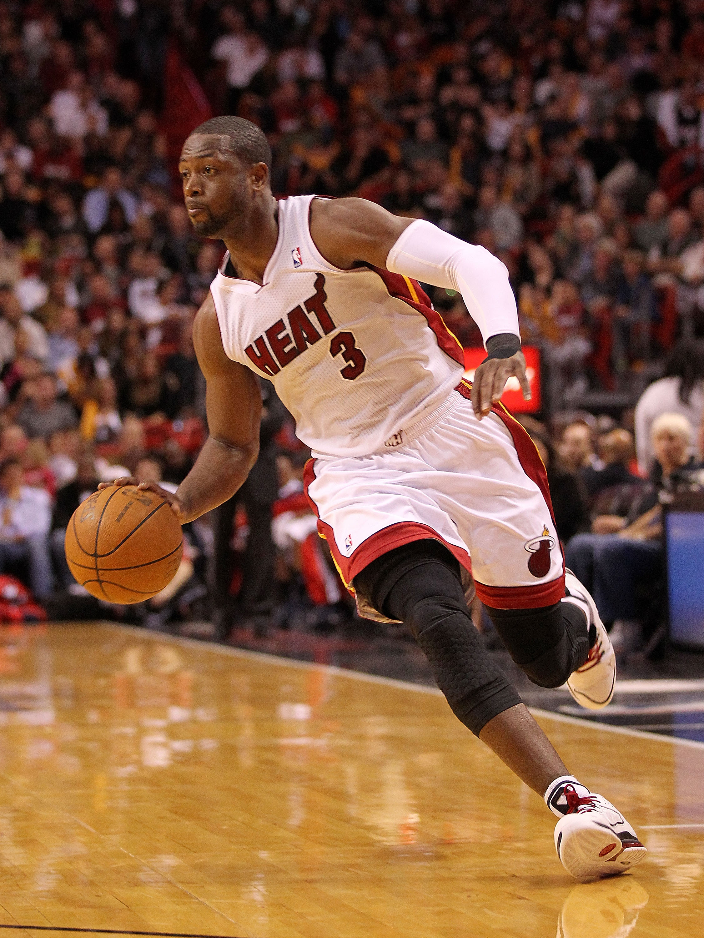 MIAMI, FL - DECEMBER 04:  Dwyane Wade #3 of the Miami Heat dribbles during a game against the Atlanta Hawks at American Airlines Arena on December 4, 2010 in Miami, Florida. NOTE TO USER: User expressly acknowledges and agrees that, by downloading and/or