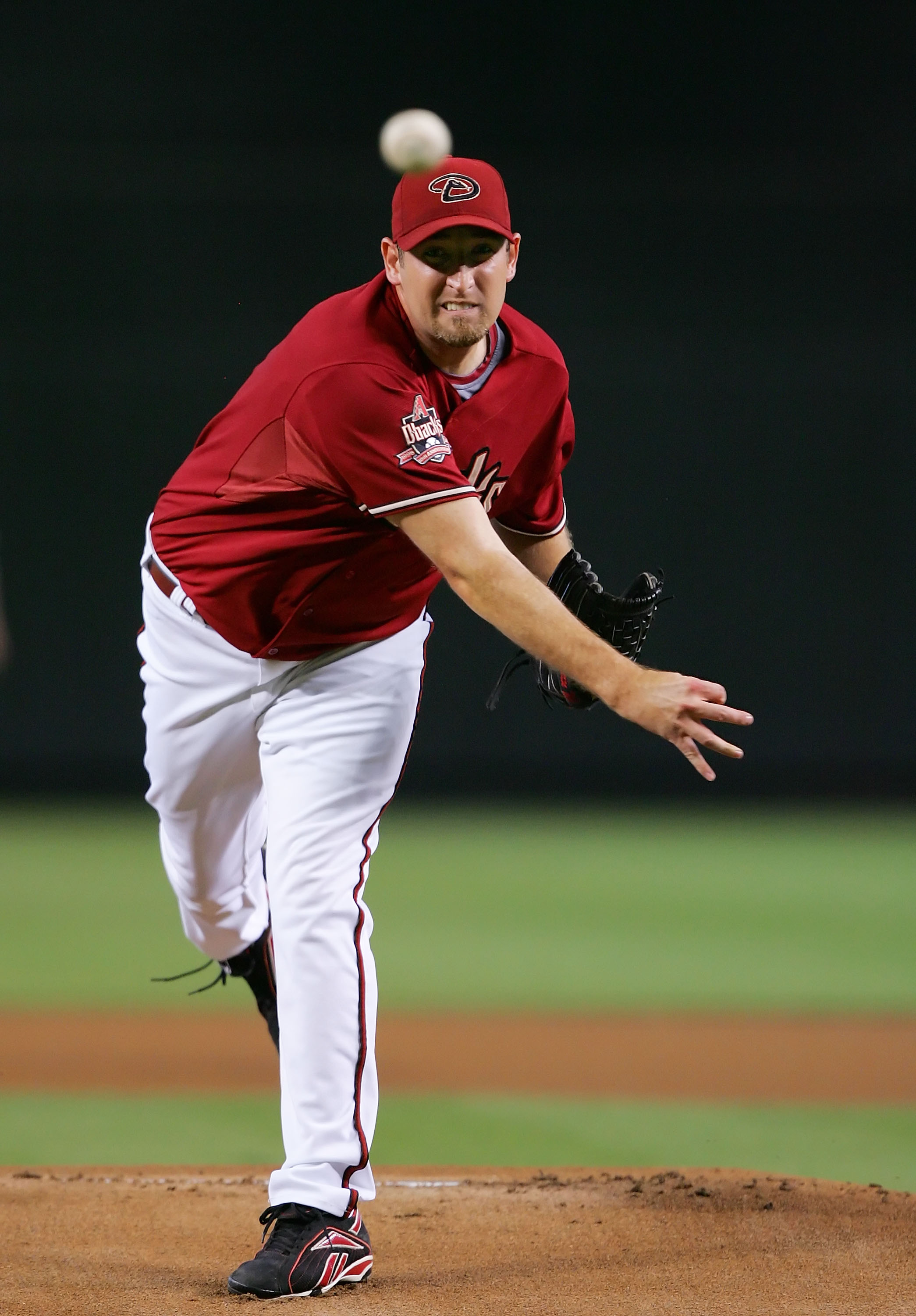 PHOENIX - AUGUST 05:  Brandon Webb #17 of the Arizona Diamondbacks pitches during a game against the Pittsburgh Pirates at Chase Field on August 5, 2008 in Phoenix, Arizona.  (Photo by Lisa Blumenfeld/Getty Images)