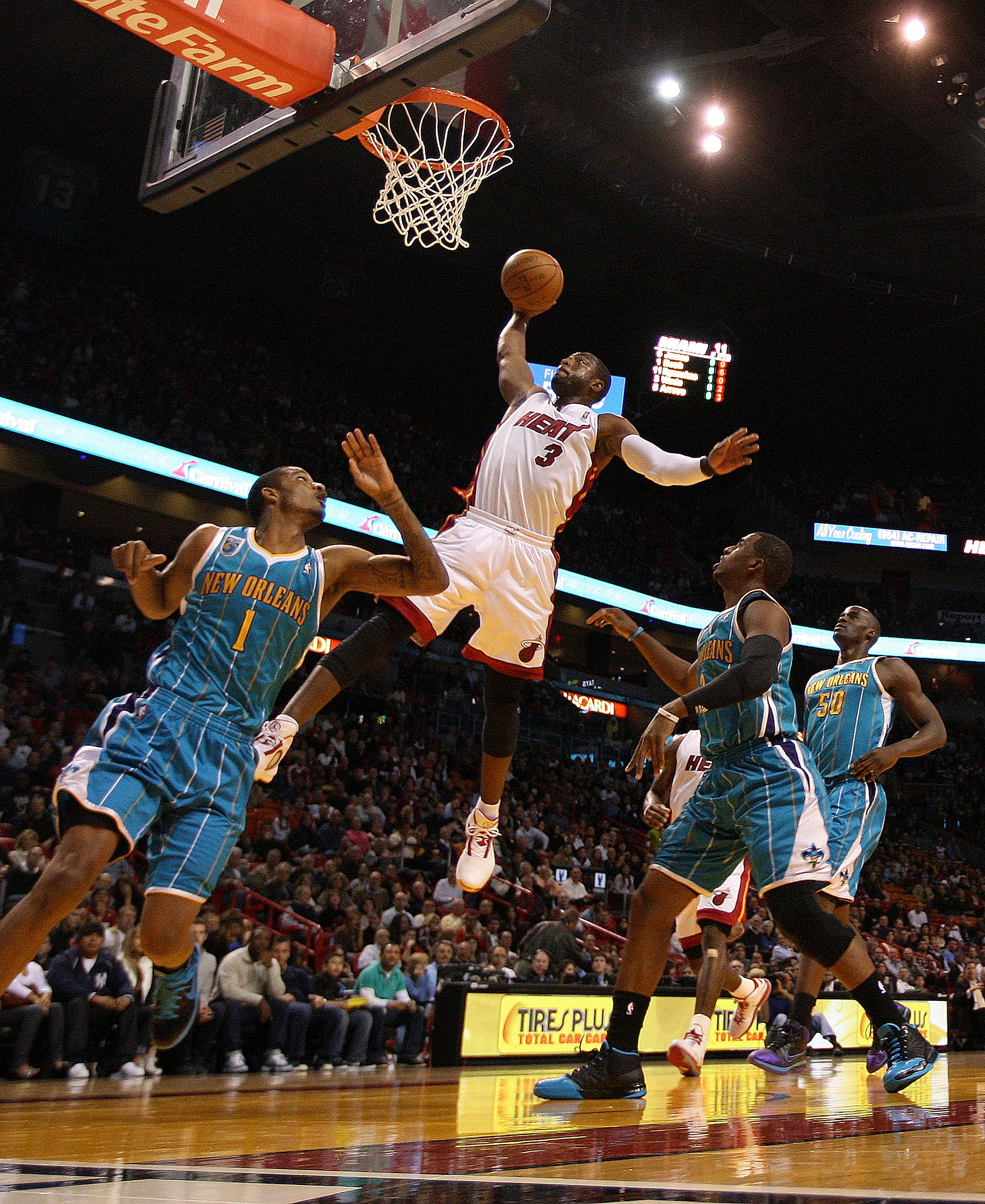 MIAMI, FL - DECEMBER 13:  Dwyane Wade #3 of the Miami Heat drives to the hoop during a game against the New Orleans Hornets at American Airlines Arena on December 13, 2010 in Miami, Florida. NOTE TO USER: User expressly acknowledges and agrees that, by do