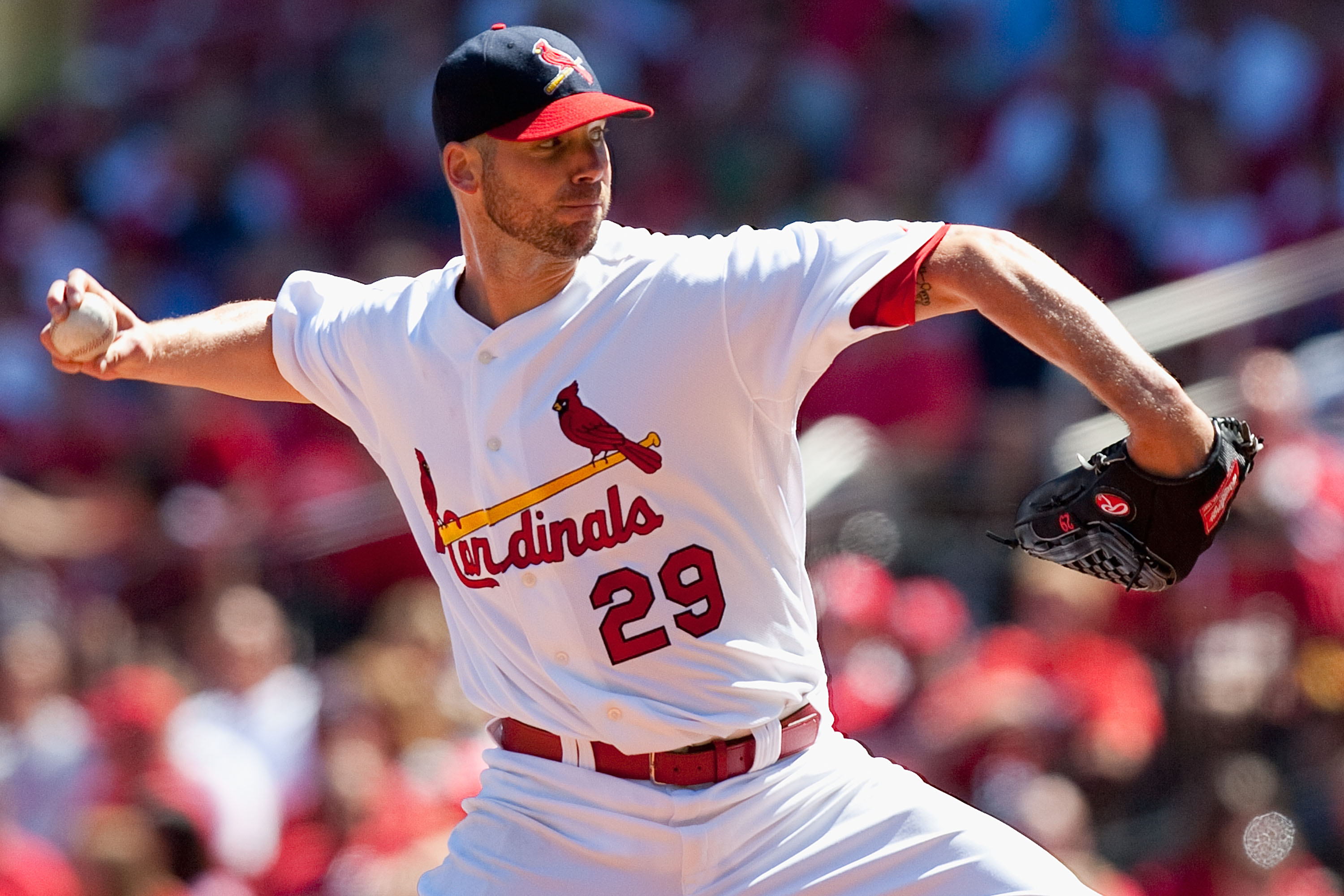 ST. LOUIS - SEPTEMBER 5: Starter Chris Carpenter #29 of the St. Louis Cardinals pitches against the Cincinnati Reds at Busch Stadium on September 5, 2010 in St. Louis, Missouri.  The Cardinals beat the Reds 4-2.  (Photo by Dilip Vishwanat/Getty Images)
