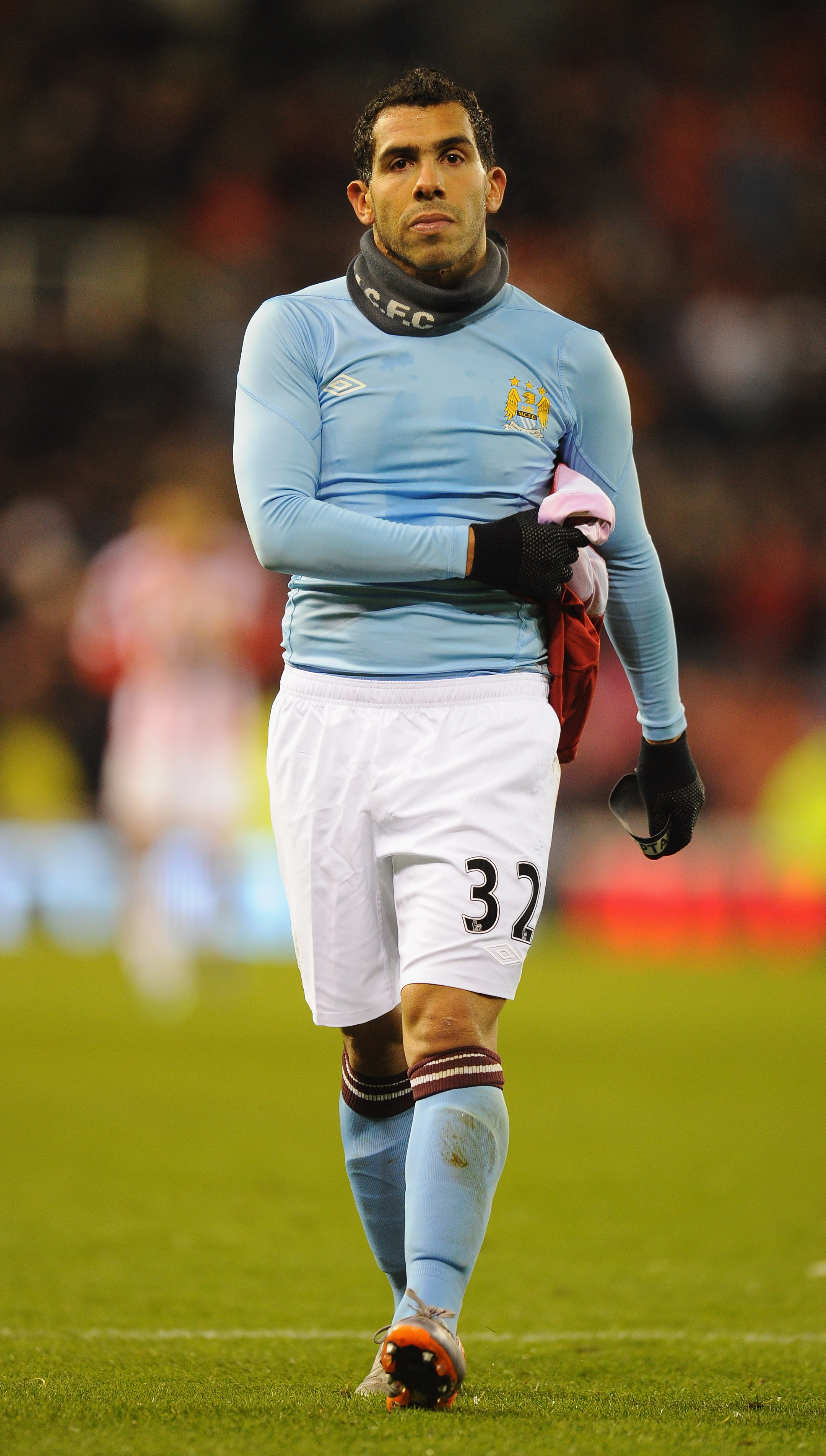 STOKE ON TRENT, ENGLAND - NOVEMBER 27:  Carlos Tevez of Manchester City walks off at the end of the Barclays Premier League match between Stoke City and Manchester City at Britannia Stadium on November 27, 2010 in Stoke on Trent, England.  (Photo by Clive