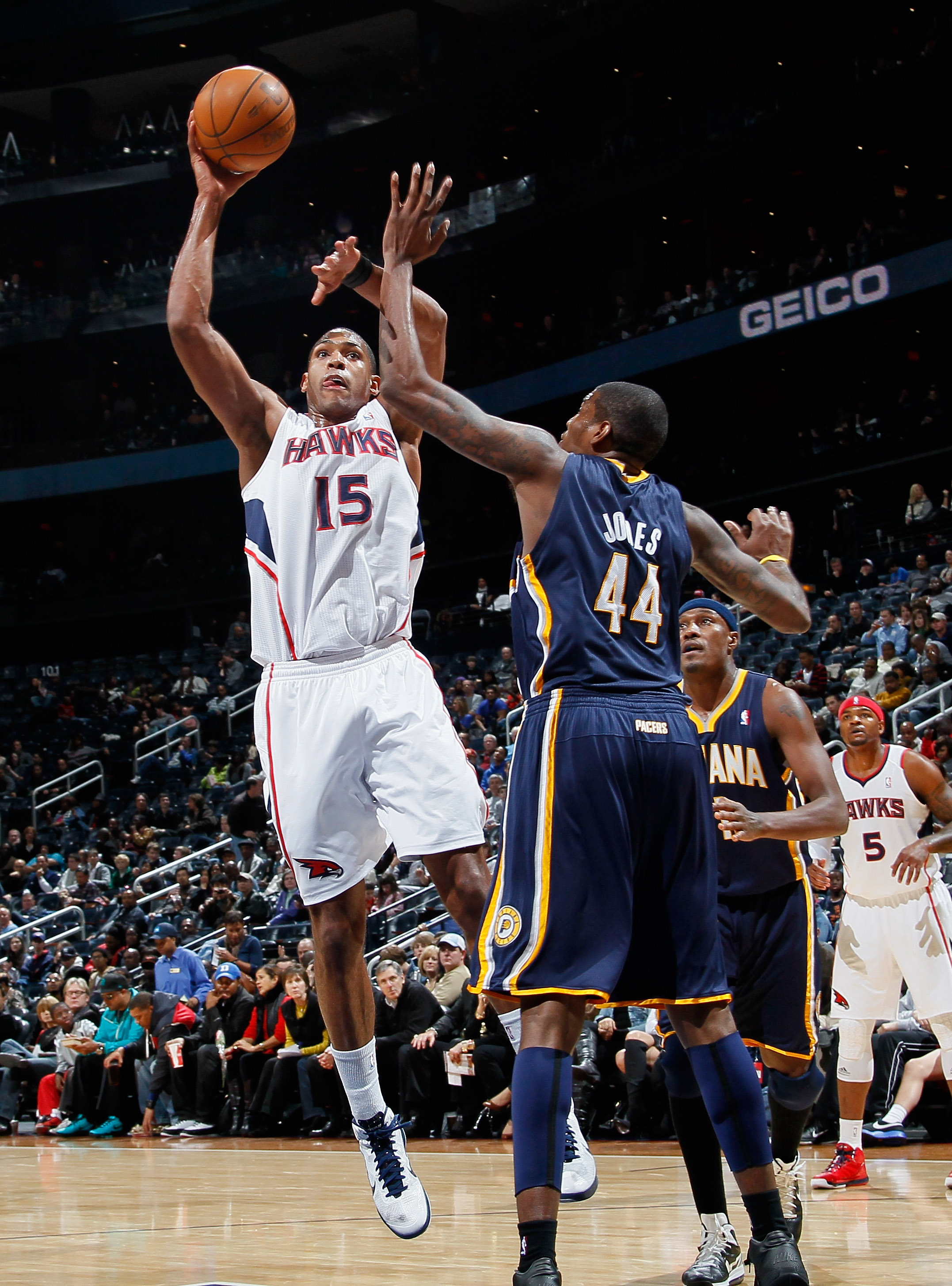 ATLANTA, GA - DECEMBER 11:  Al Horford #15 of the Atlanta Hawks shoots over Solomon Jones #44 of the Indiana Pacers at Philips Arena on December 11, 2010 in Atlanta, Georgia.  NOTE TO USER: User expressly acknowledges and agrees that, by downloading and/o