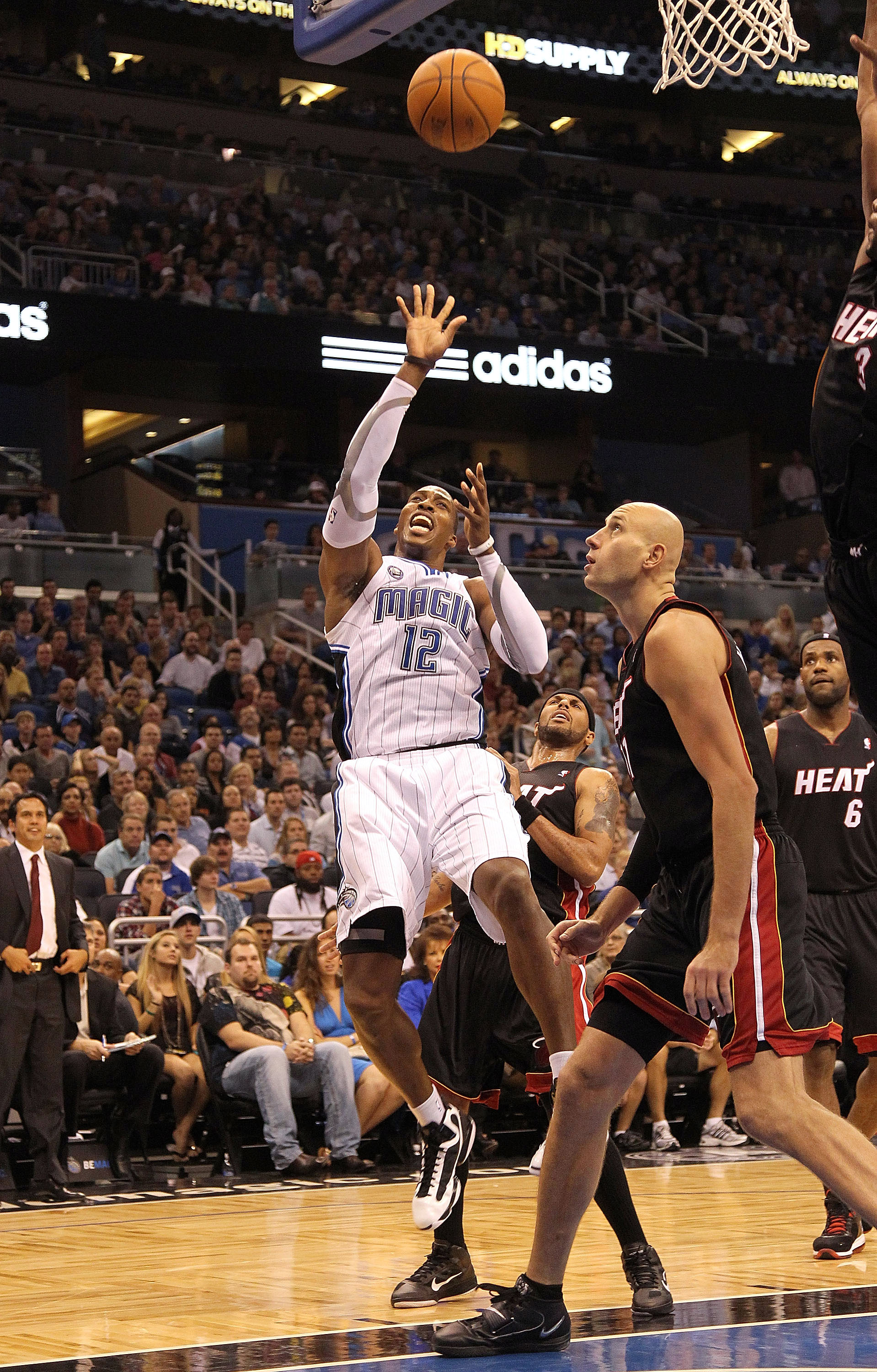 ORLANDO, FL - NOVEMBER 24:  Dwight Howard #12 of the Orlando Magic shoots over Zydrunas Ilgauskas #11 of the Miami Heat during a game at Amway Arena on November 24, 2010 in Orlando, Florida. NOTE TO USER: User expressly acknowledges and agrees that, by do