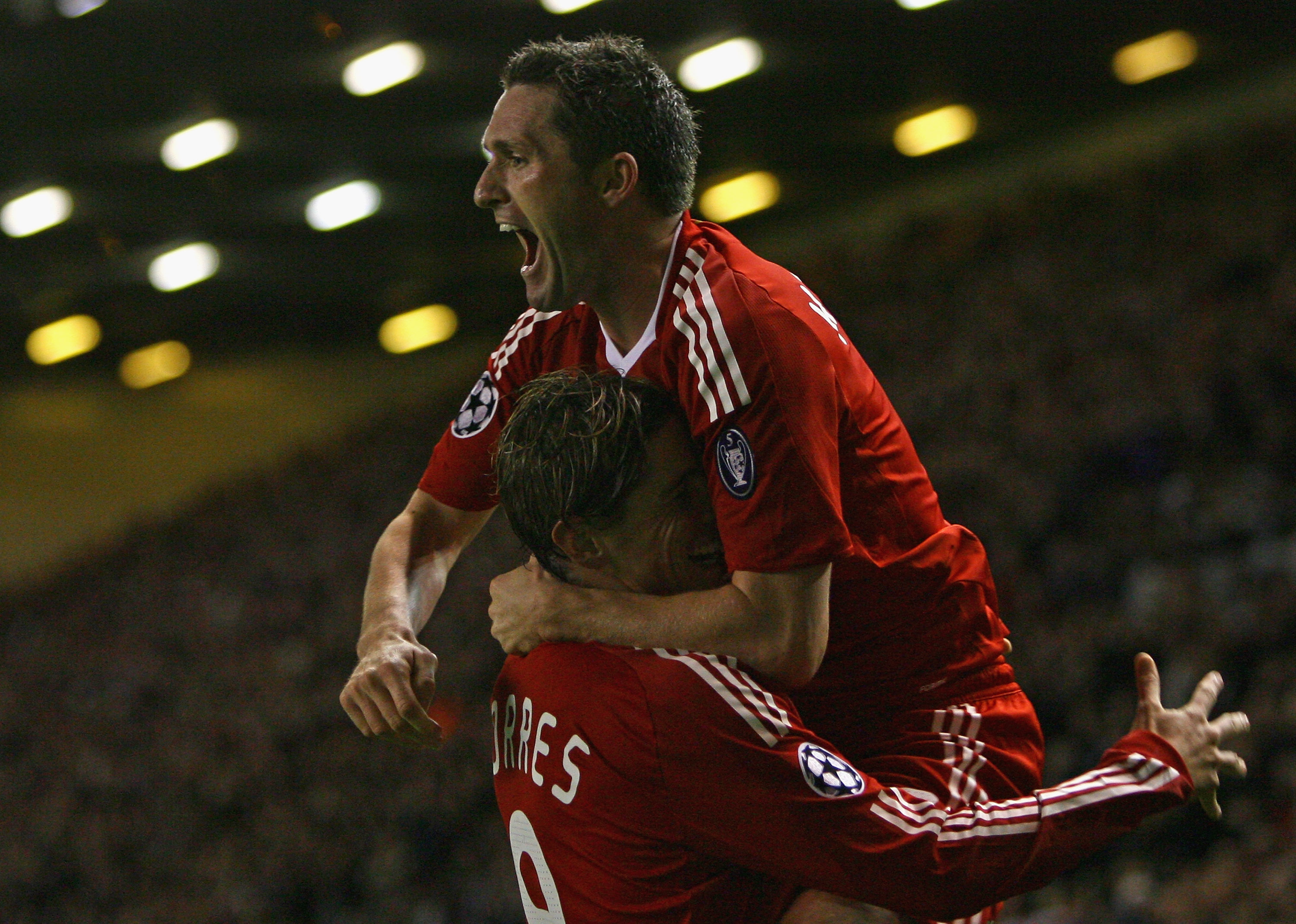 LIVERPOOL, UNITED KINGDOM - OCTOBER 01:  Robbie Keane of Liverpool celebrates scoring his team's second goal with team mate Fernando Torres during the UEFA Champions League Group D match between Liverpool and PSV Eindhoven at Anfield on October 1, 2008 in