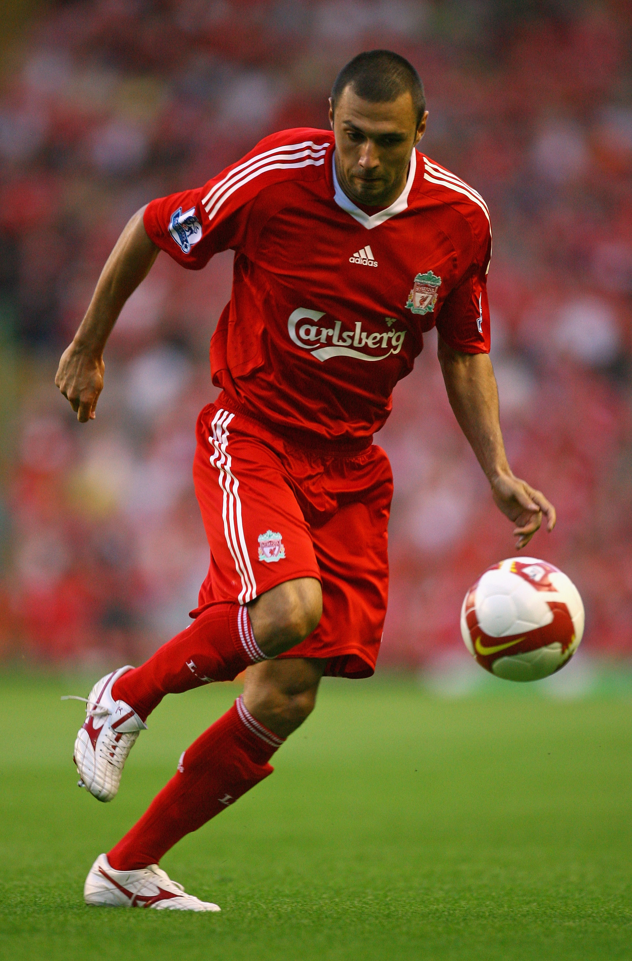 LIVERPOOL, UNITED KINGDOM - AUGUST 08:  Andrea Dossena of Liverpool during the pre season friendly match between Liverpool and Lazio at Anfield on August 8, 2008 in Liverpool, England.  (Photo by Alex Livesey/Getty Images)