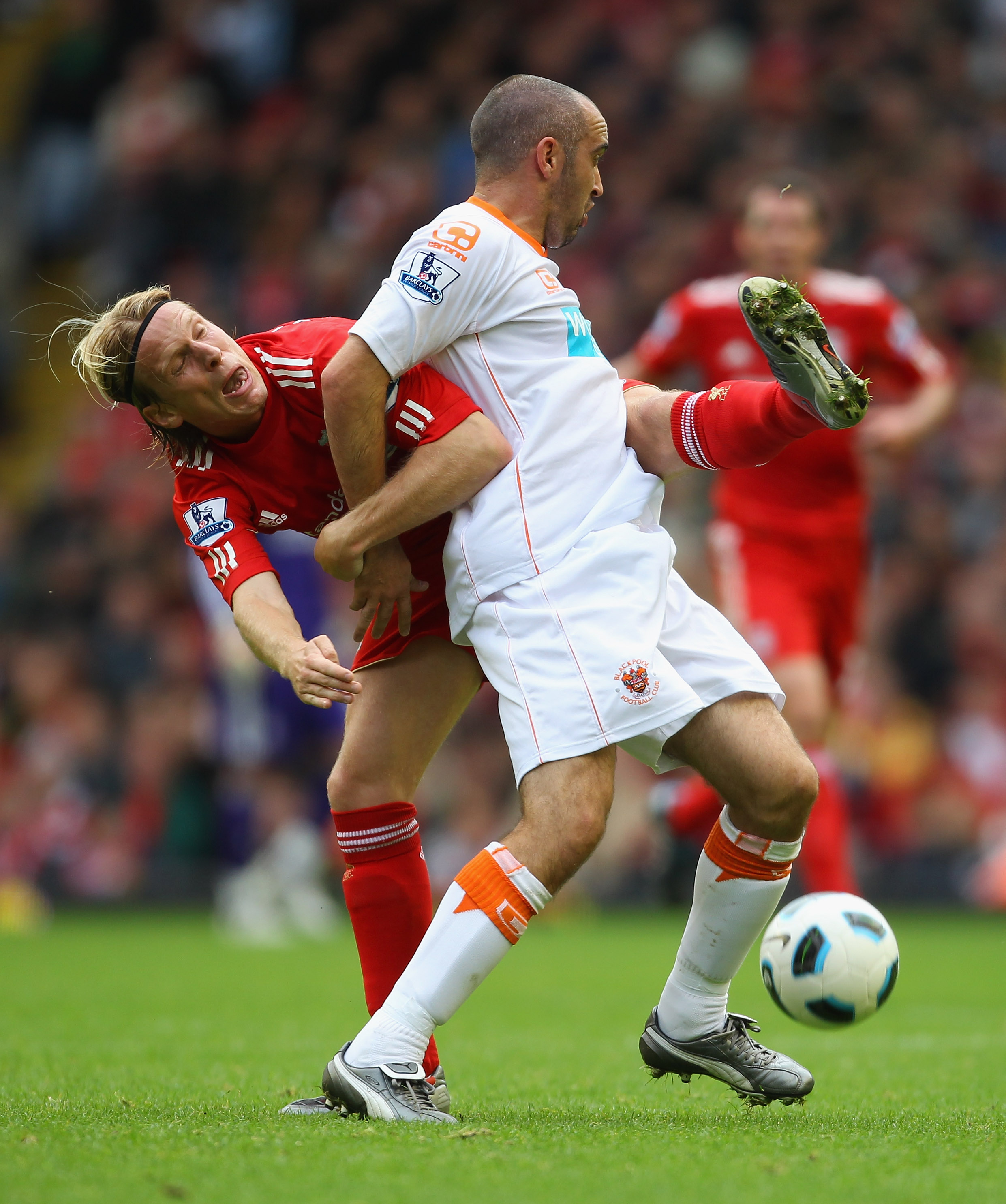 LIVERPOOL, ENGLAND - OCTOBER 03:  Gary Taylor-Fletcher of Blackpool holds off a challenge from Christian Poulsen during the Barclays Premier League match between Liverpool and Blackpool at Anfield on October 3, 2010 in Liverpool, England.  (Photo by Alex