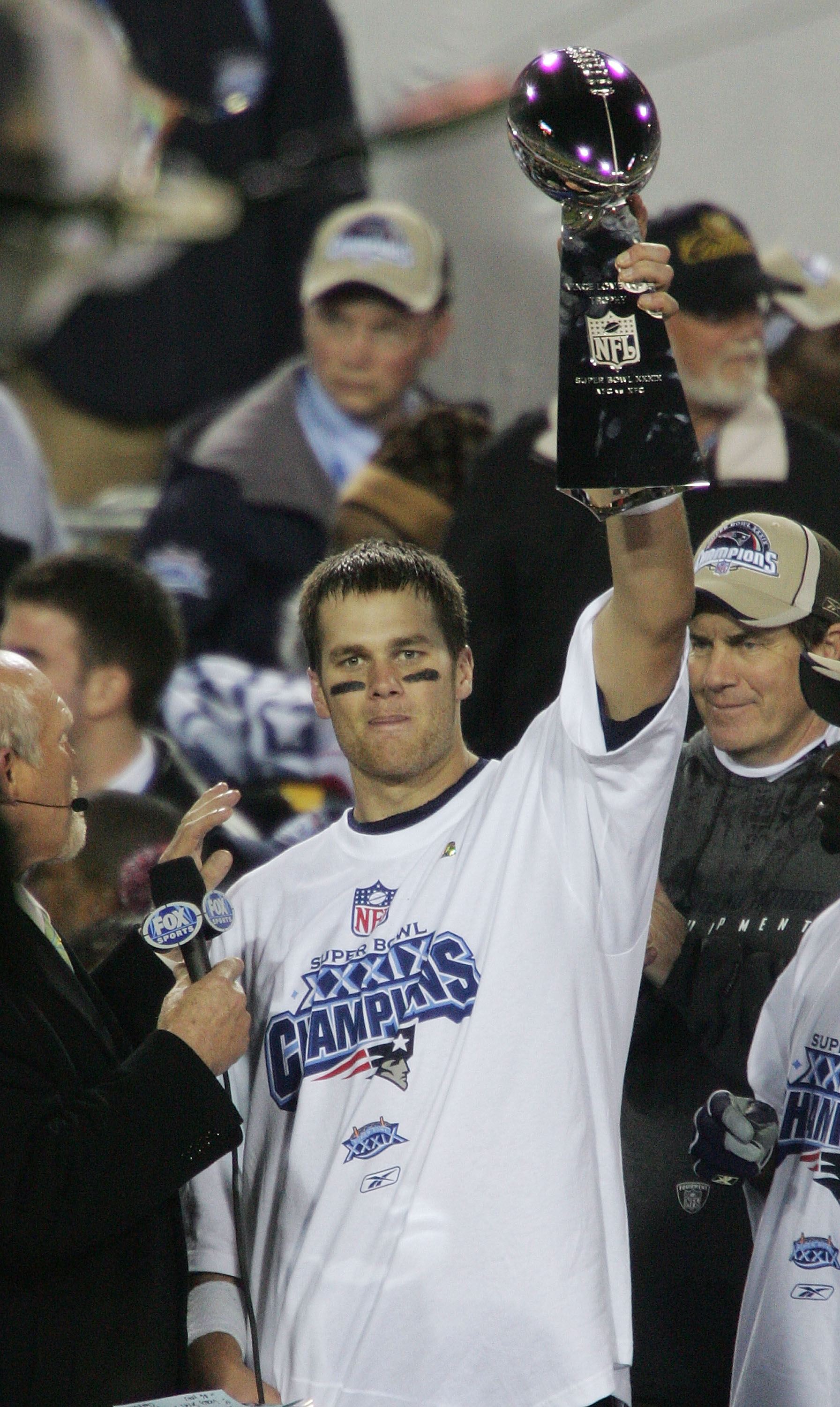 JACKSONVILLE, FLORIDA - FEBRUARY 06:  Quarterback Tom Brady #12 of the New England Patriots celebrates with the Lombardi trophy after defeating the Philadelphia Eagles in Super Bowl XXXIX at Alltel Stadium on February 6, 2005 in Jacksonville, Florida.  Th