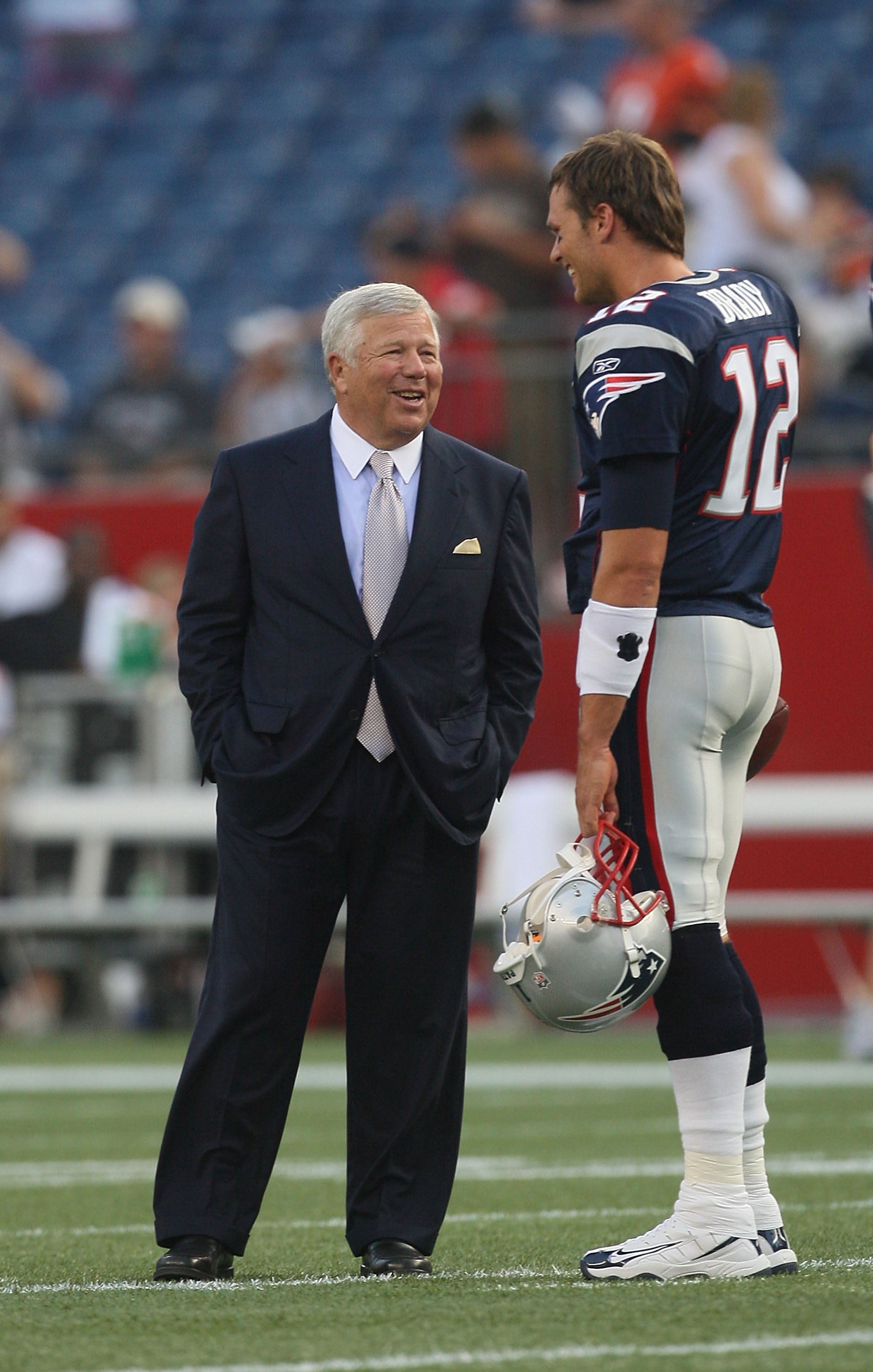FOXBORO, MA - AUGUST 20:  Tom Brady #12 of the New England Patriots chats with owner Robert Kraft before a game against the Cincinnati Bengals at Gillette Stadium on August 20, 2009 in Foxboro, Massachusetts. (Photo by Jim Rogash/Getty Images)
