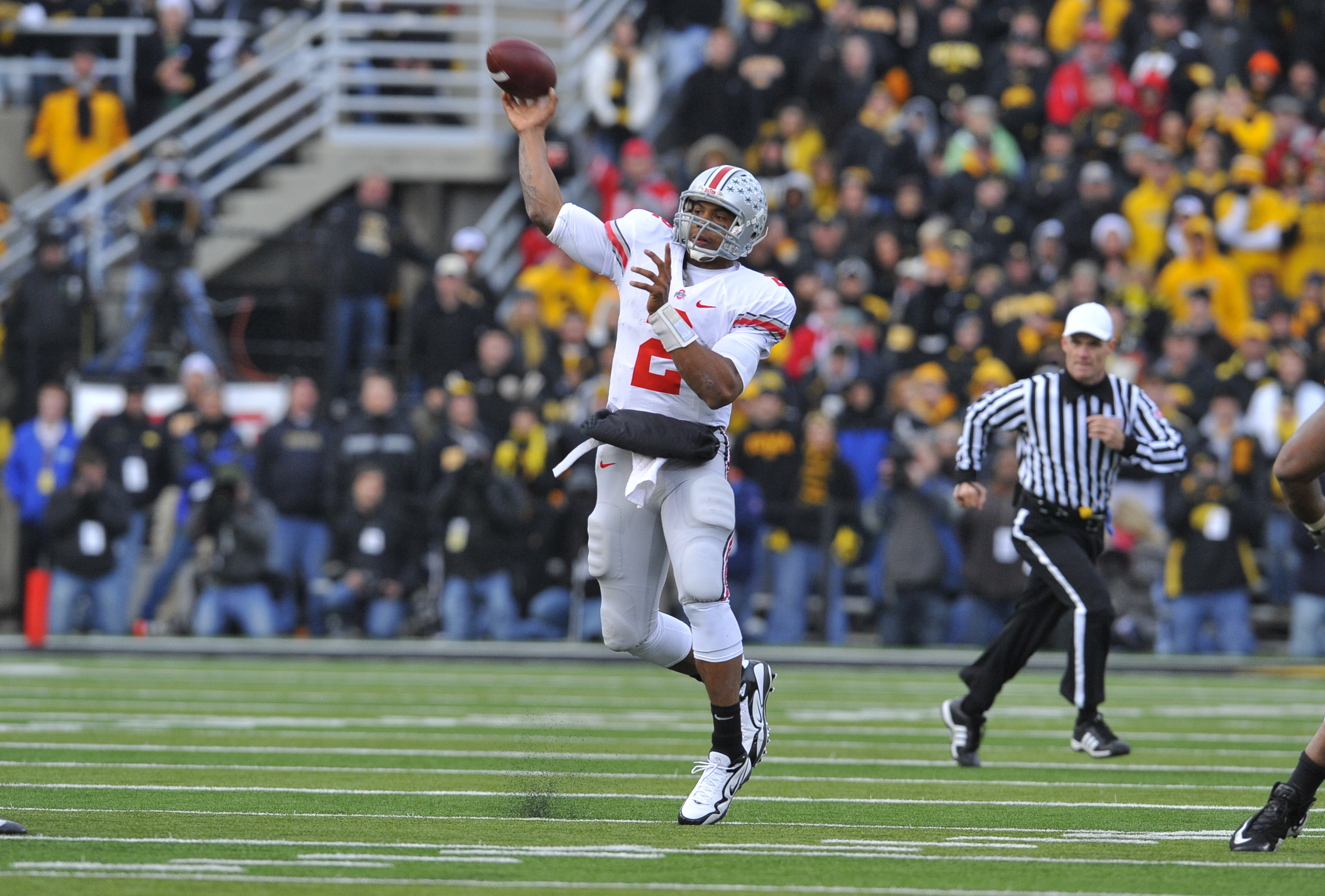 IOWA CITY, IA - NOVEMBER 20:  Quarterback Terrelle Pryor #2 of the Ohio State Buckeyes throws under pressure from University of Iowa Hawkeyes defenders during the second half of play at Kinnick Stadium on November 20, 2010 in Iowa City, Iowa. Ohio State w