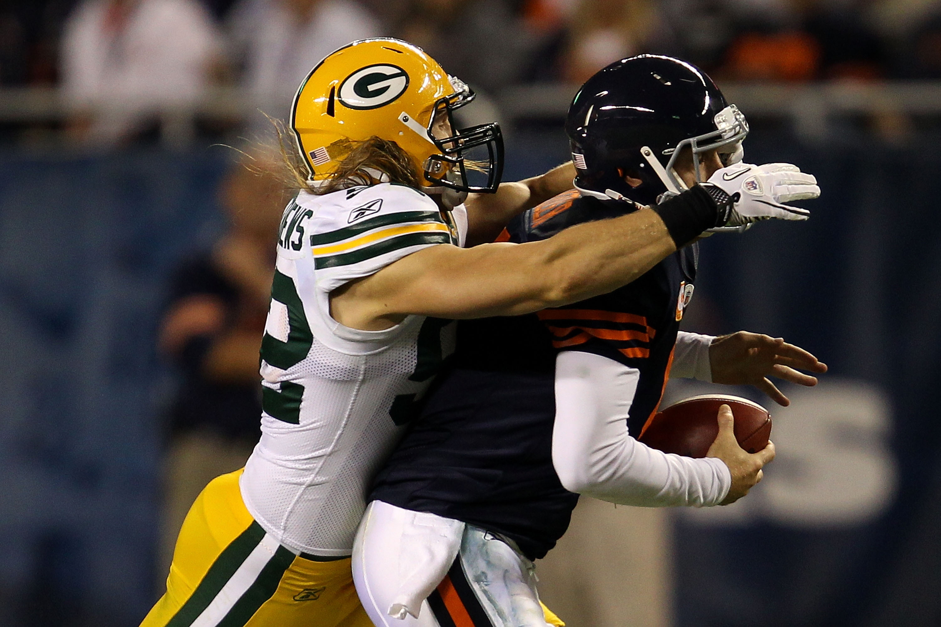 CHICAGO - SEPTEMBER 27:  Clay Matthews #52 of the Green Bay Packers is called for a facemask as he pulls down Jay Cutler #6 of the Chicago Bears in the first quarter at Soldier Field on September 27, 2010 in Chicago, Illinois.  (Photo by Jonathan Daniel/G