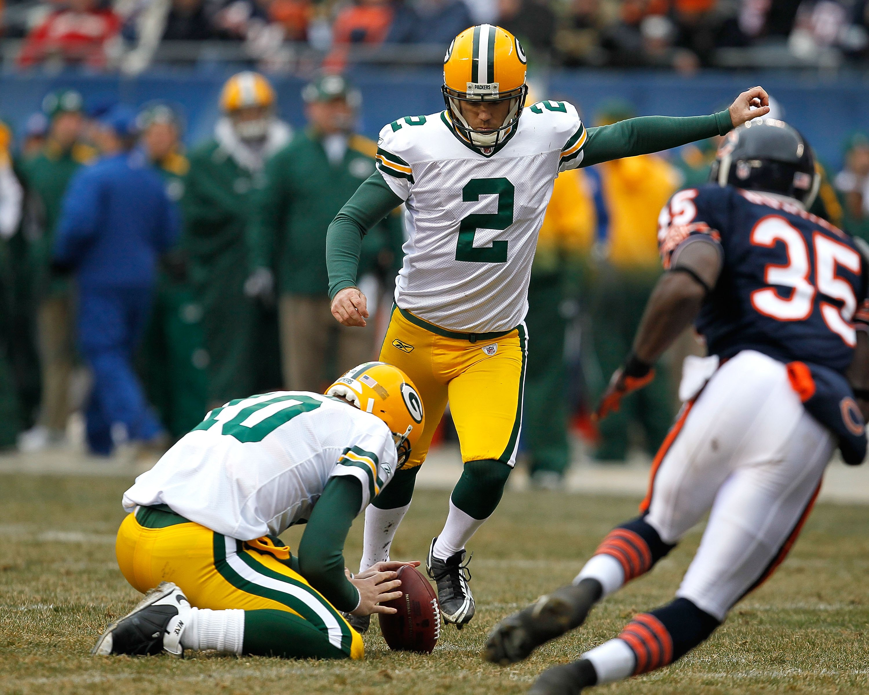 CHICAGO - DECEMBER 13: Mason Crosby #2 of the Green Bay Packers kicks an extra point out of the hold of Matt Flynn #10 against the Chicago Bears at Soldier Field on December 13, 2009 in Chicago, Illinois. The Packers defeated the Bears 21-14. (Photo by Jo