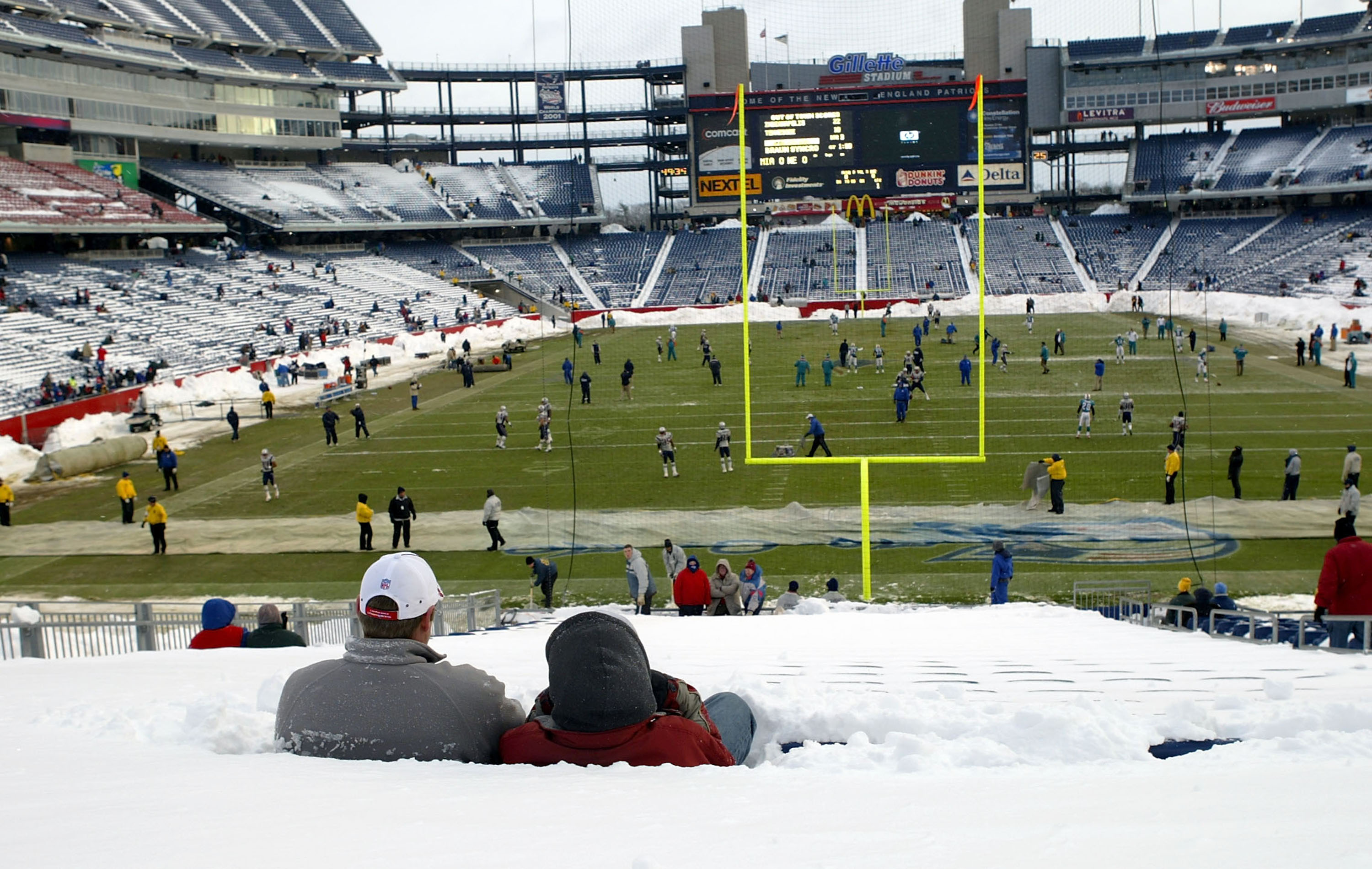FOXBORO, MA - DECEMBER 7:  Fans sit in snow-covered seats before the Miami Dolphins game against the New England Patriots on December 7, 2003 at Gillette Stadium in Foxboro, Massachusetts.  (Photo by Ezra Shaw/Getty Images)