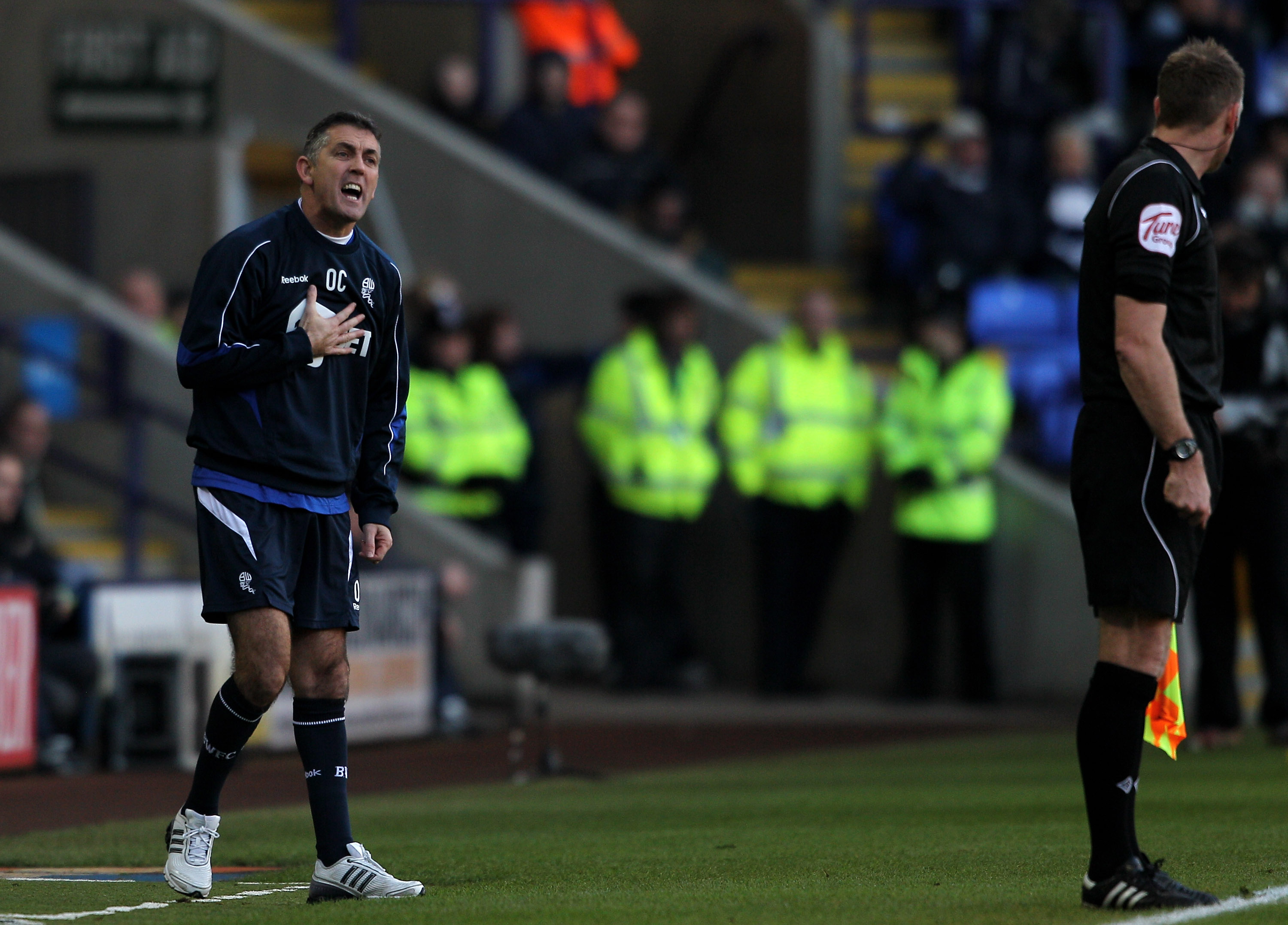 BOLTON, ENGLAND - DECEMBER 12:  Bolton Wanderers Manager Owen Coyle makes a point to the Assistant Referee during the Barclays Premier League match between Bolton Wanderers and Blackburn Rovers at the Reebok Stadium on December 12, 2010 in Bolton, England