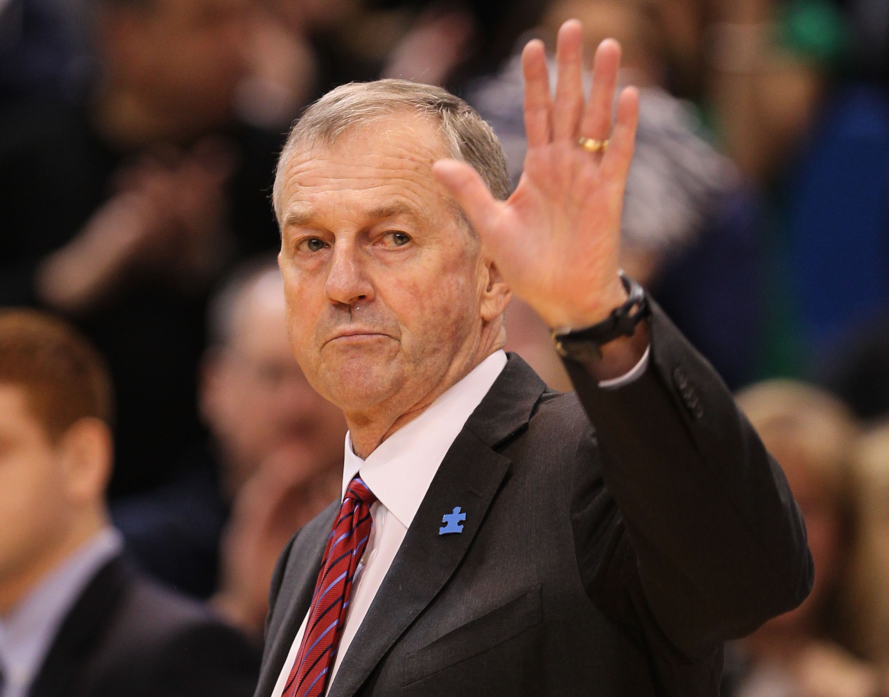 HARTFORD, CT - FEBRUARY 13: Coach Jim Calhoun of the Connecticut Huskies reacts to fans as he walks onto the court before a game against the Cincinnati Bearcats at the XL Center on February 13, 2010 in Hartford, Connecticut. (Photo by Jim Rogash/Getty Ima