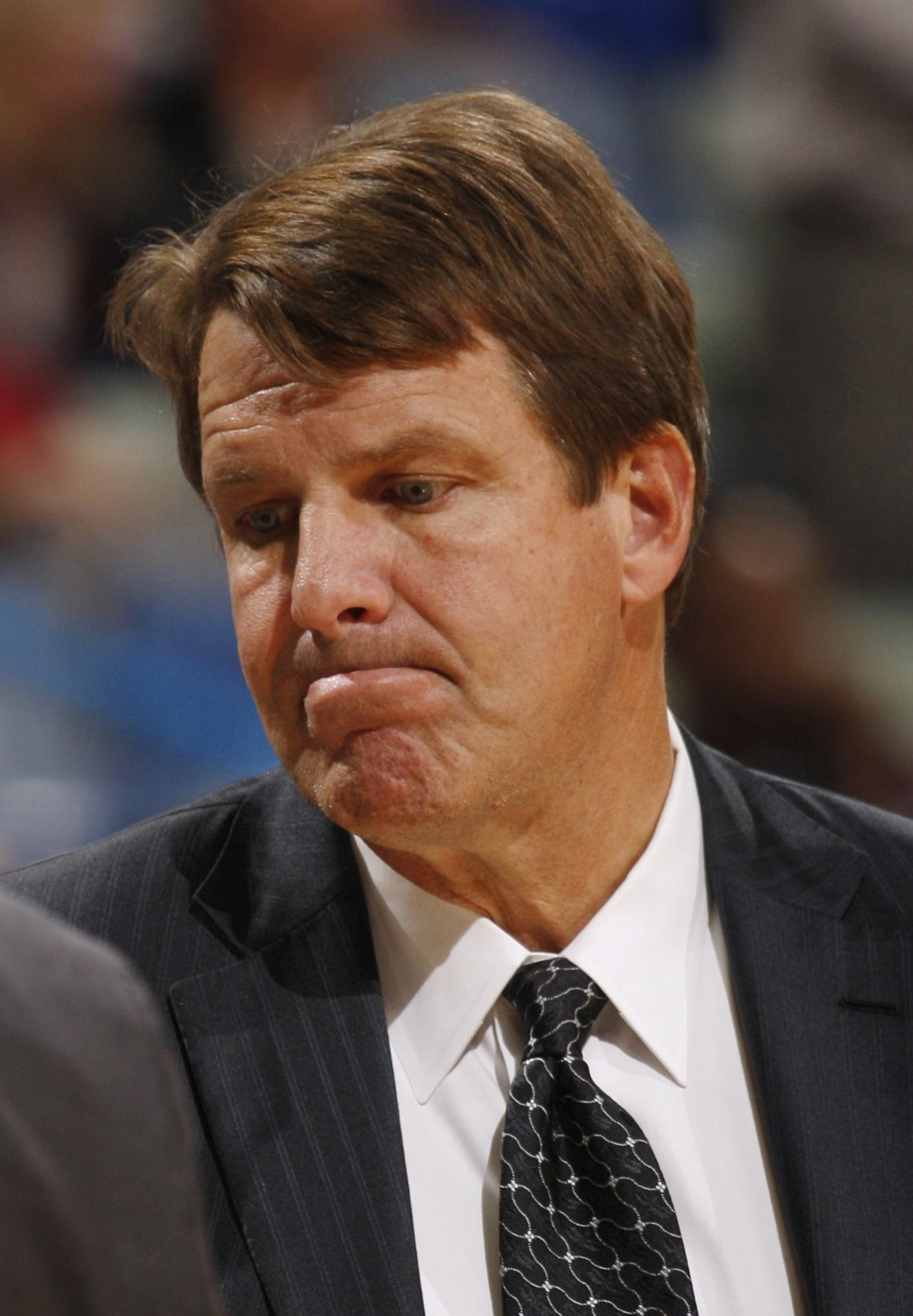 NEW ORLEANS - NOVEMBER 13:  Assistant Coach Tim Floyd of the New Orleans Hornets looks on during the game against the Portland Trail Blazers at New Orleans Arena on November 13, 2009 in New Orleans, Louisiana.  NOTE TO USER: User expressly acknowledges an