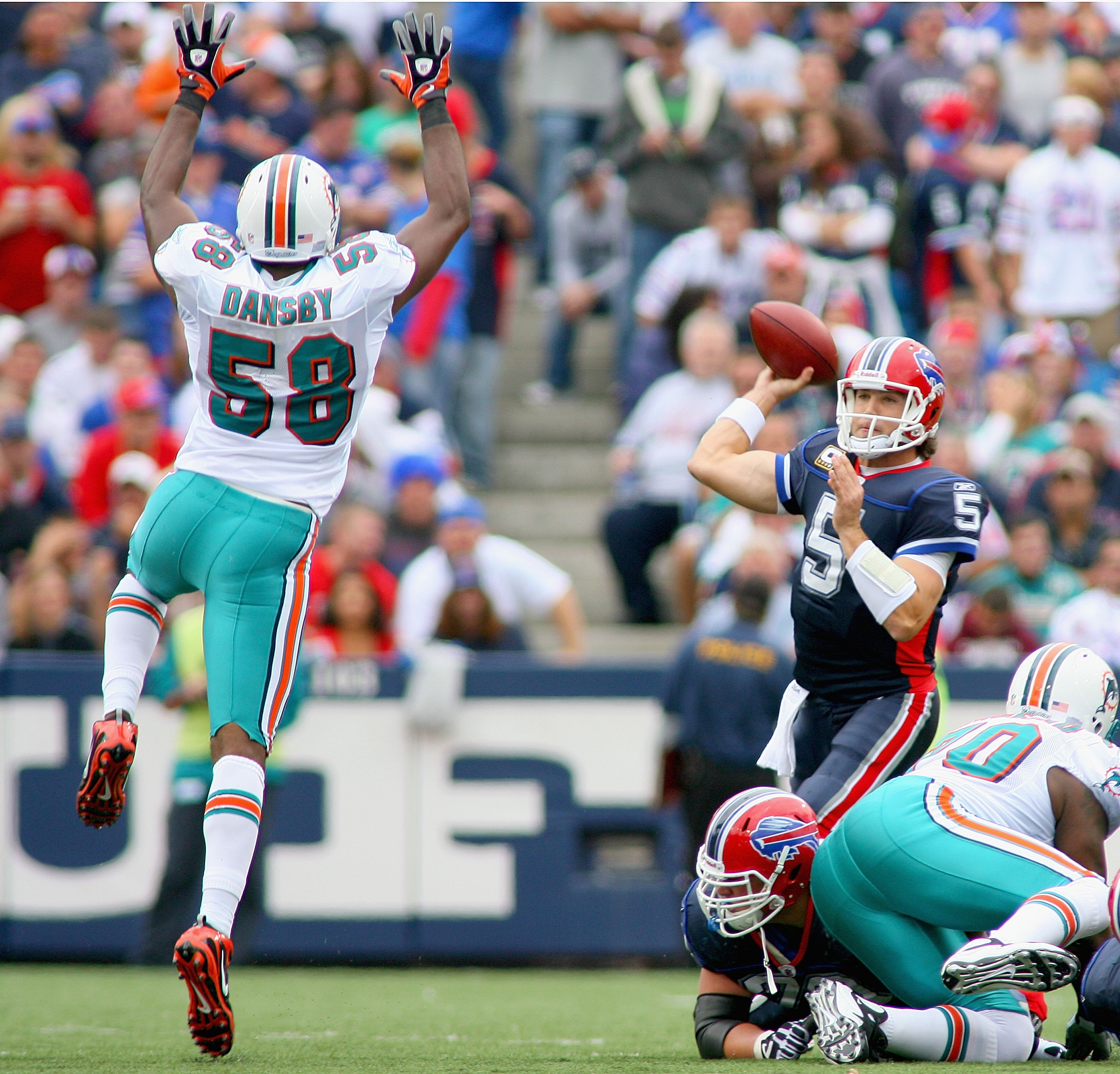 ORCHARD PARK, NY - SEPTEMBER 12: Trent Edwards #5 of the Buffalo Bills throws a pass under pressure from Karlos Dansby #58 of the Miami Dolphins during the NFL season opener at Ralph Wilson Stadium on September 12, 2010 in Orchard Park, New York. Miami wo