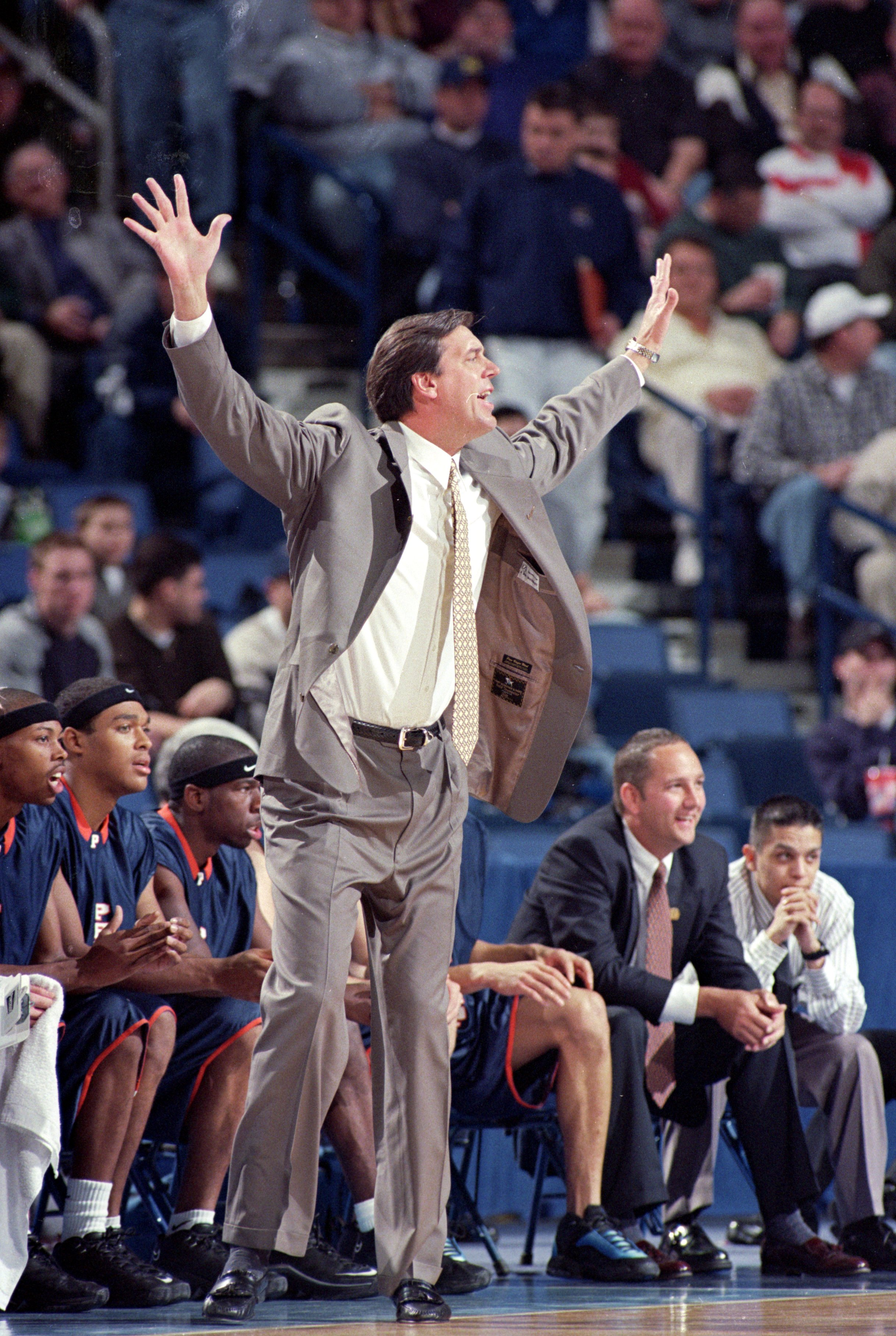 19 Mar 2000: Jan van Breda Kolff of the Pepperdine Waves reacts on  the sidelines during round one of the NCAA Tournament Game against the Oklahoma State Cowboys at the Marine Midland Arena in Buffalo, New York. The Cowboys defeated the Waves 75-67. Manda