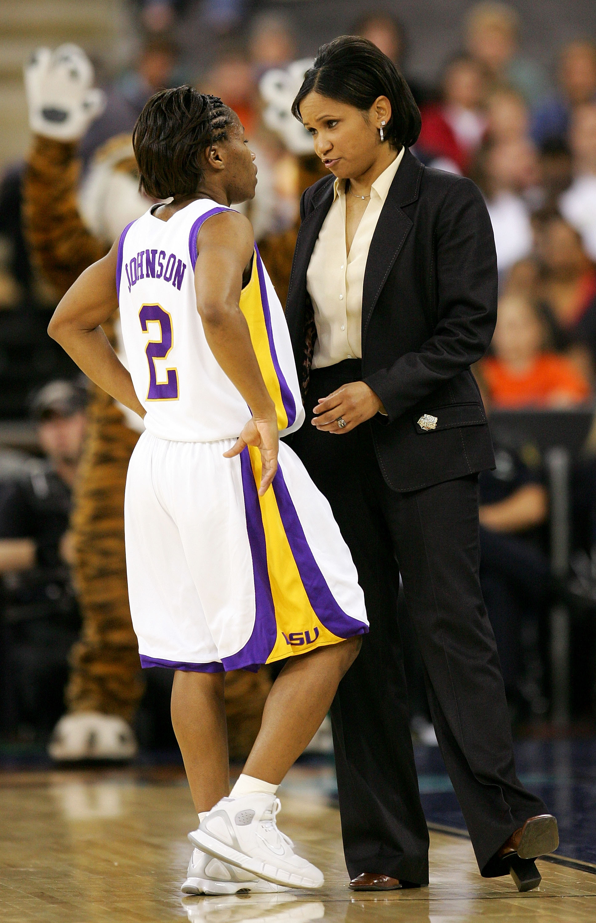 INDIANAPOLIS - APRIL 3:  Head coach Pokey Chatman talks to Temeka Johnson #2 of the Louisiana State Lady Tigers during a break in the action against of the Baylor Lady Bears in the Semifinal game of the Women's NCAA Basketball Championship on April 3, 200