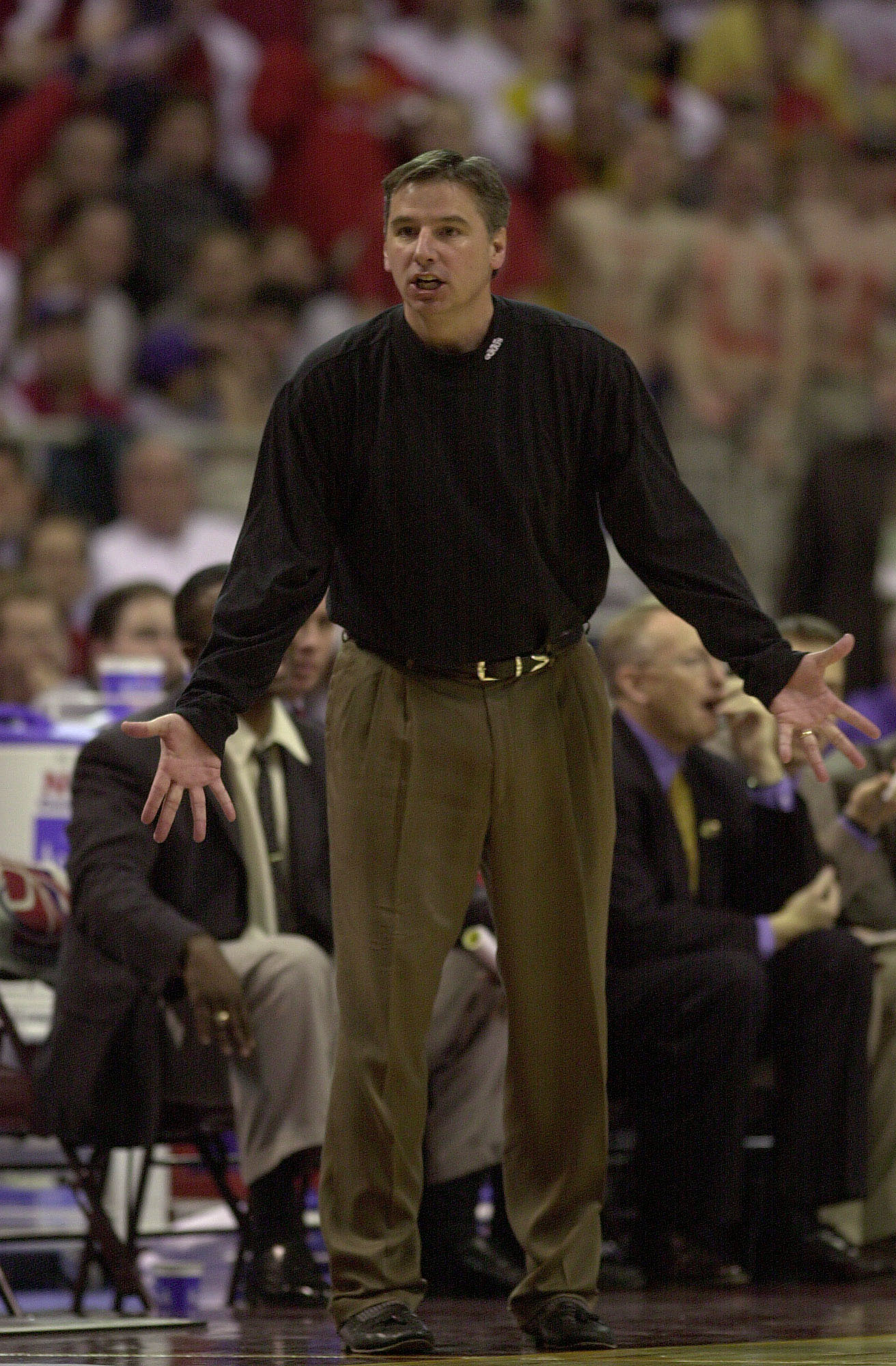 18 Mar 2000: Iowa St head coach Larry Eustachy directs his players during the game against Auburn during the Second Round of the NCAA Midwest Regional at the Hubert H. Humphrey Metrodome in Minneapolis, Minnesota. Iowa State won 79-60. DIGITAL IMAGE.
