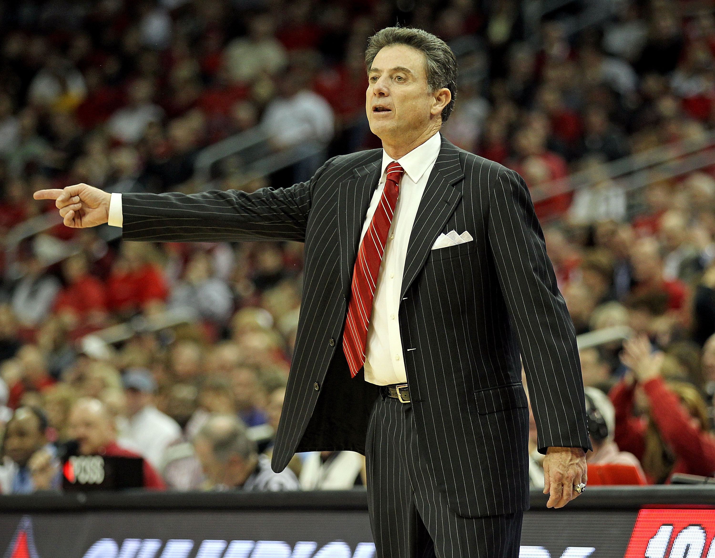 LOUISVILLE, KY - NOVEMBER 22:  Rick Pitino the Head Coach of the Louisville Cardinals gives instructions to his team during the game against  Chattanooga Mocs at the KFC Yum! CENTER on November 22, 2010 in Louisville, Kentucky.  Louisville won 106-65.  (P