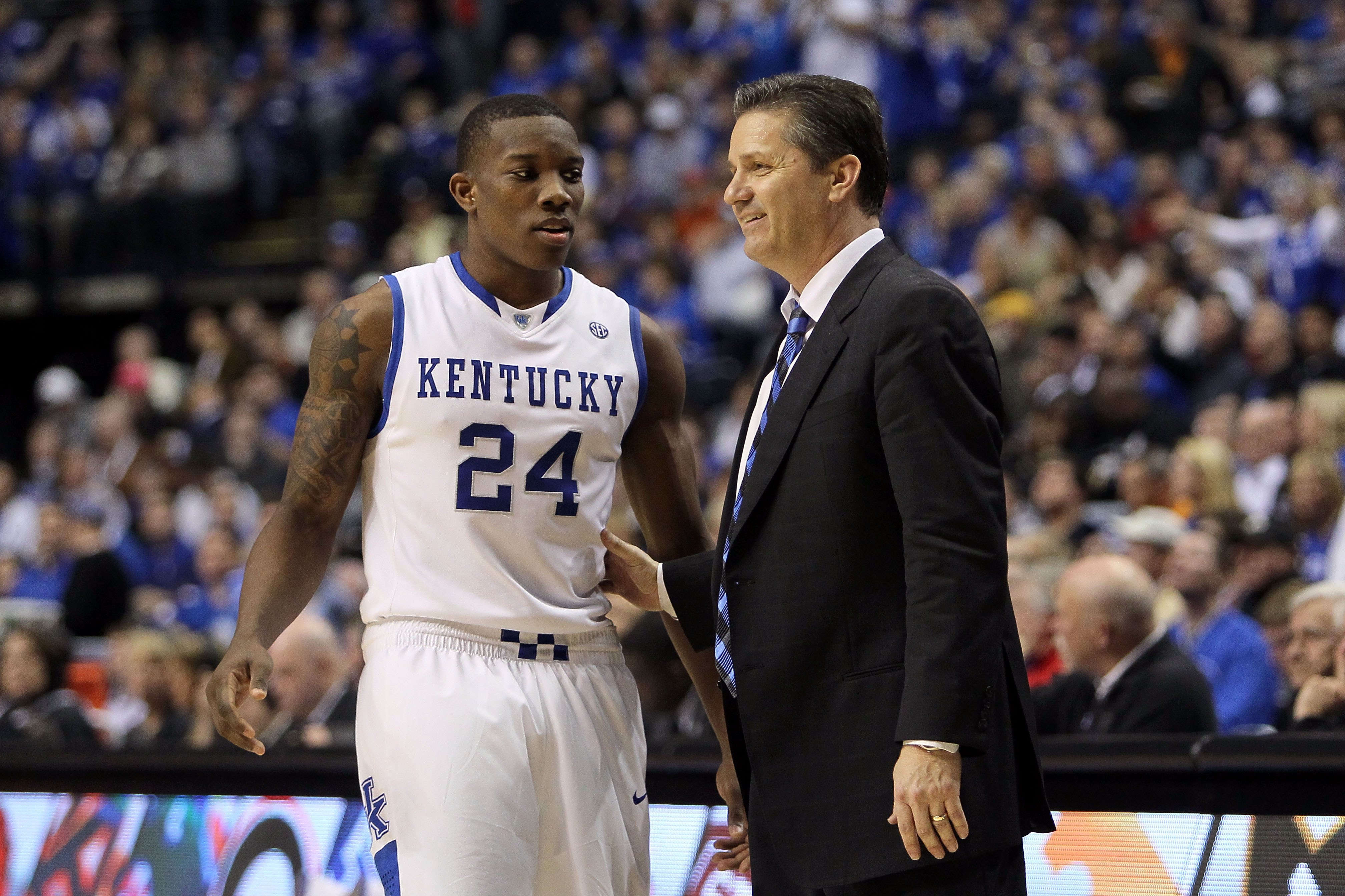 NASHVILLE, TN - MARCH 13:  Head coach John Calipari and Eric Bledsoe #24 of the Kentucky Wildcats talk on court against the Tennessee Volunteers during the semirfinals of the SEC Men's Basketball Tournament at the Bridgestone Arena on March 13, 2010 in Na