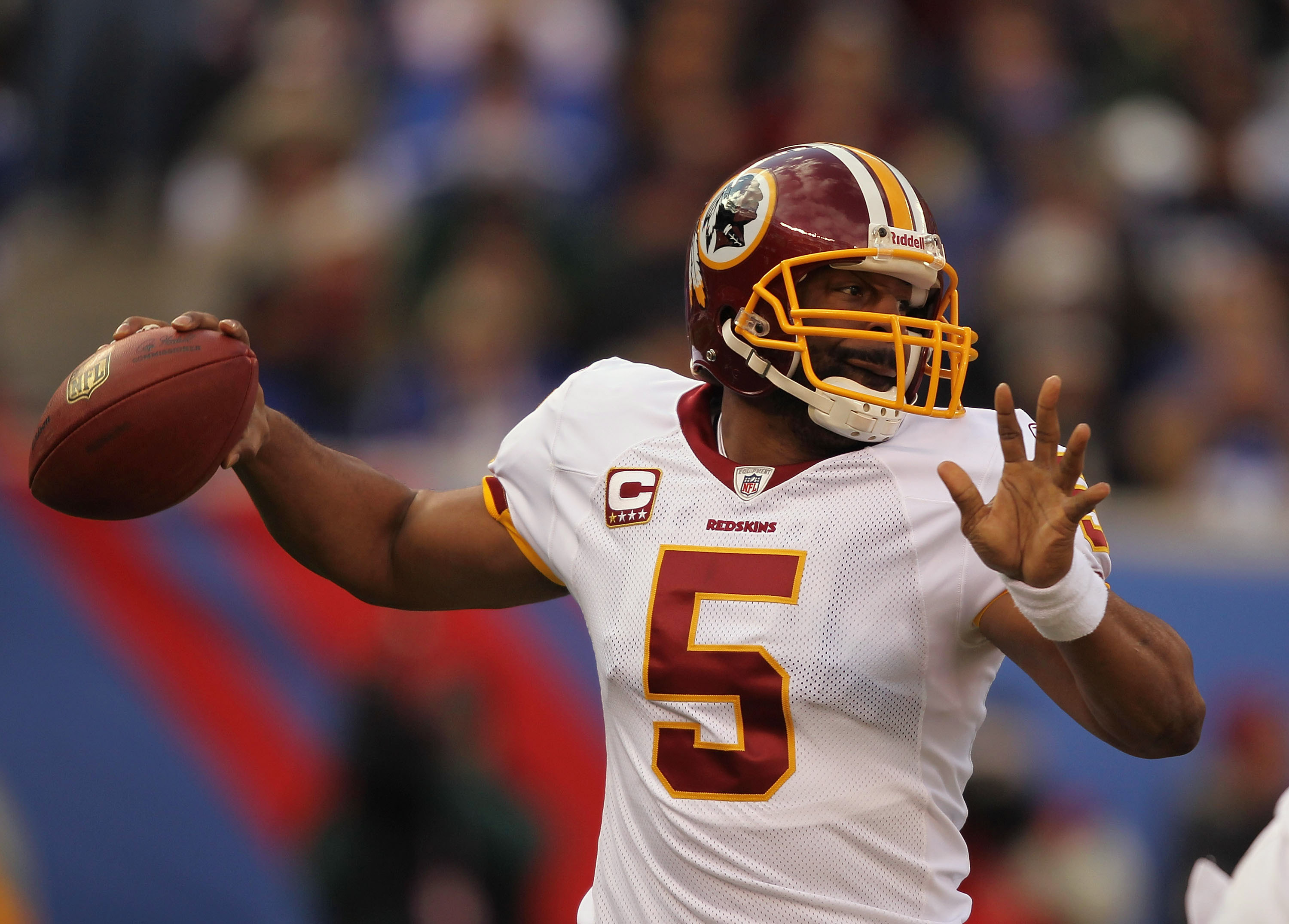 EAST RUTHERFORD, NJ - DECEMBER 05:  Donovan McNabb #5 of the Washington Redskins passes the  ball against the New York Giants  apply pressure during their game on December 5, 2010 at The New Meadowlands Stadium in East Rutherford, New Jersey.  (Photo by A