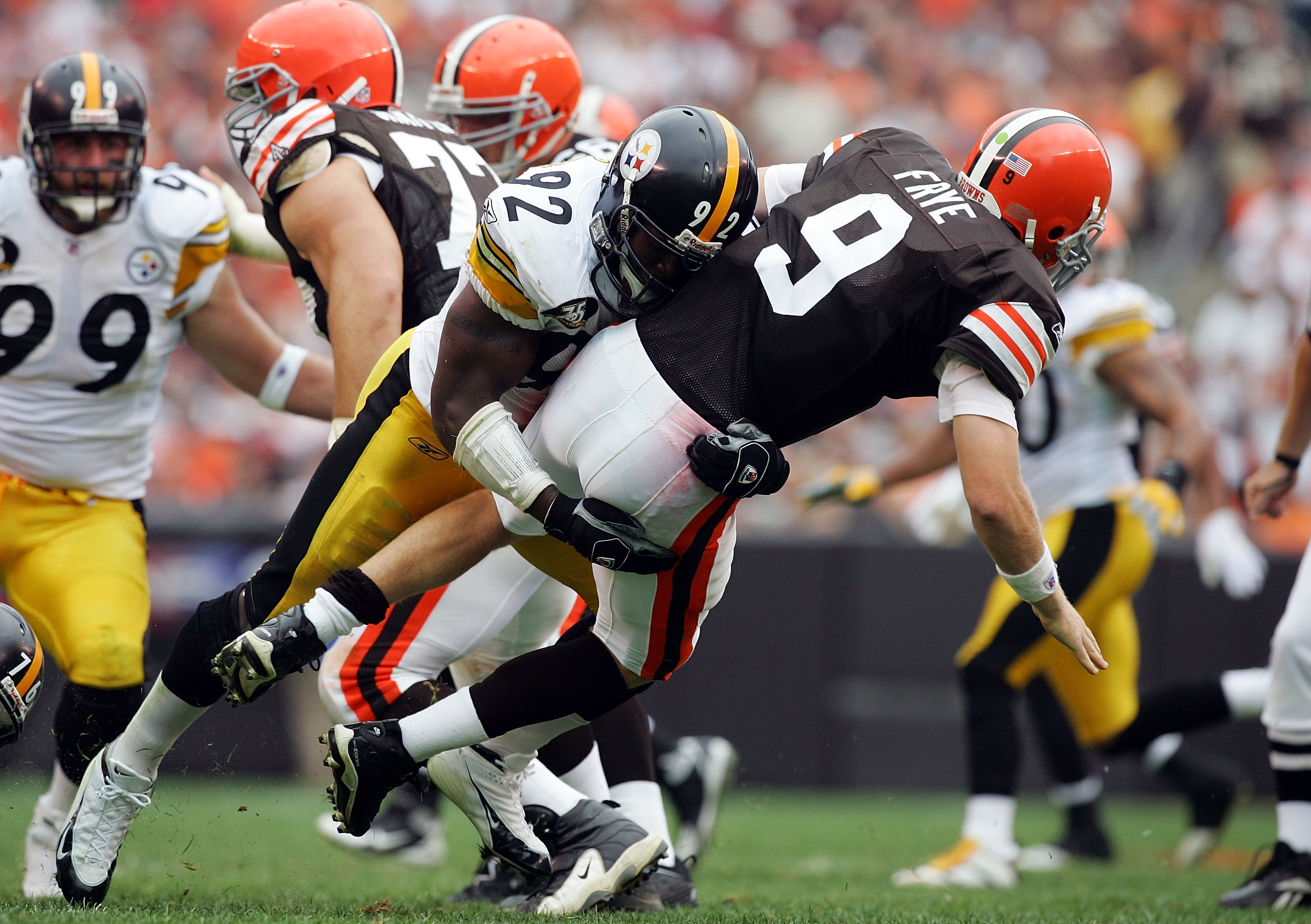 CLEVELAND - SEPTEMBER 9:  Charlie Frye #9 of the Cleveland Browns is sacked by James Harrison #92 of the Pittsburgh Steelers during their season opening game at Cleveland Browns Stadium September 9, 2007 in Cleveland, Ohio.  (Photo by Jim McIsaac/Getty Im