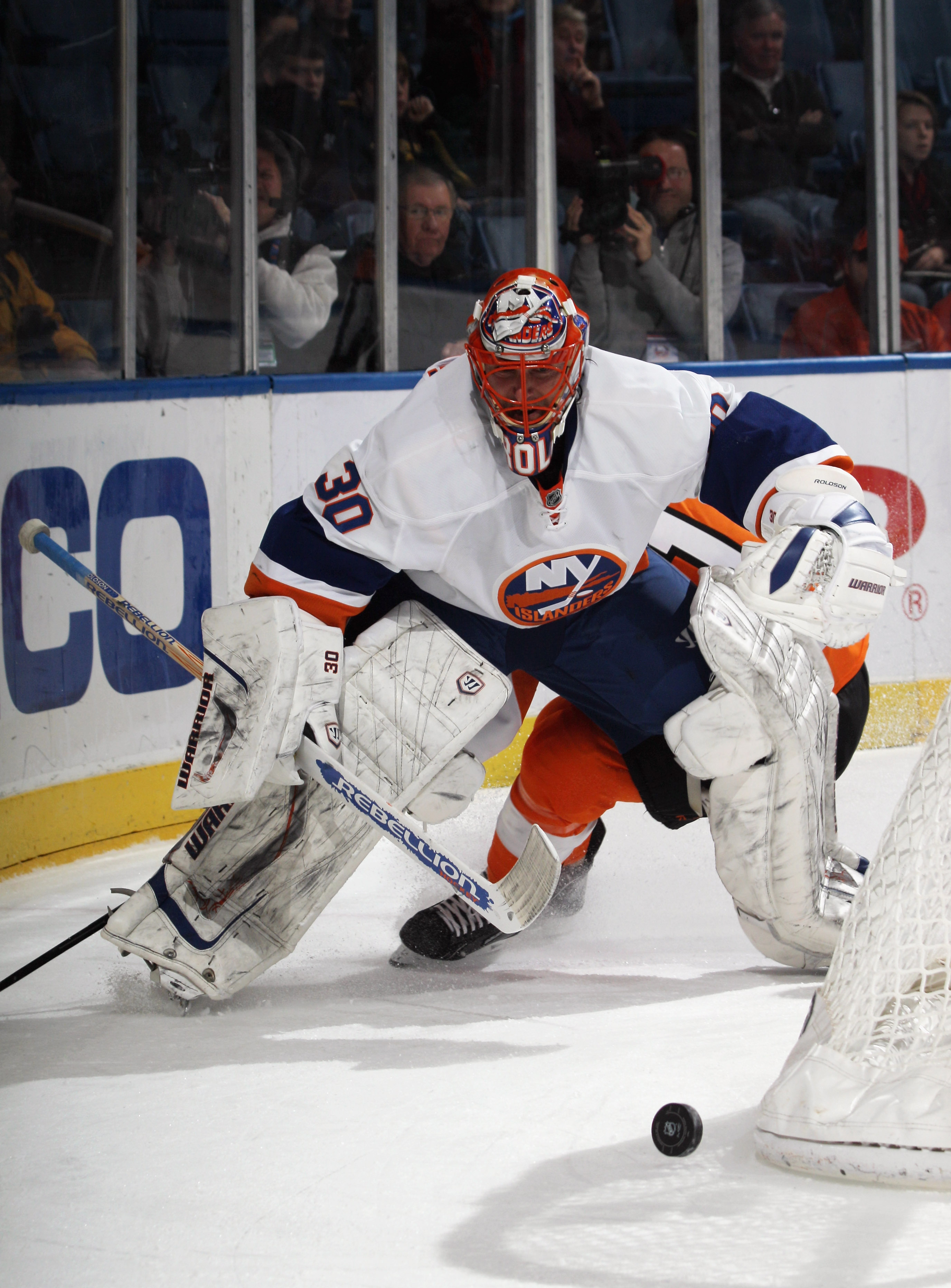 UNIONDALE, NY - DECEMBER 05: Dwayne Roloson #30 of the New York Islanders plays the puck against teh Philadelphia Flyers at the Nassau Coliseum on December 5, 2010 in Uniondale, New York.  (Photo by Bruce Bennett/Getty Images)