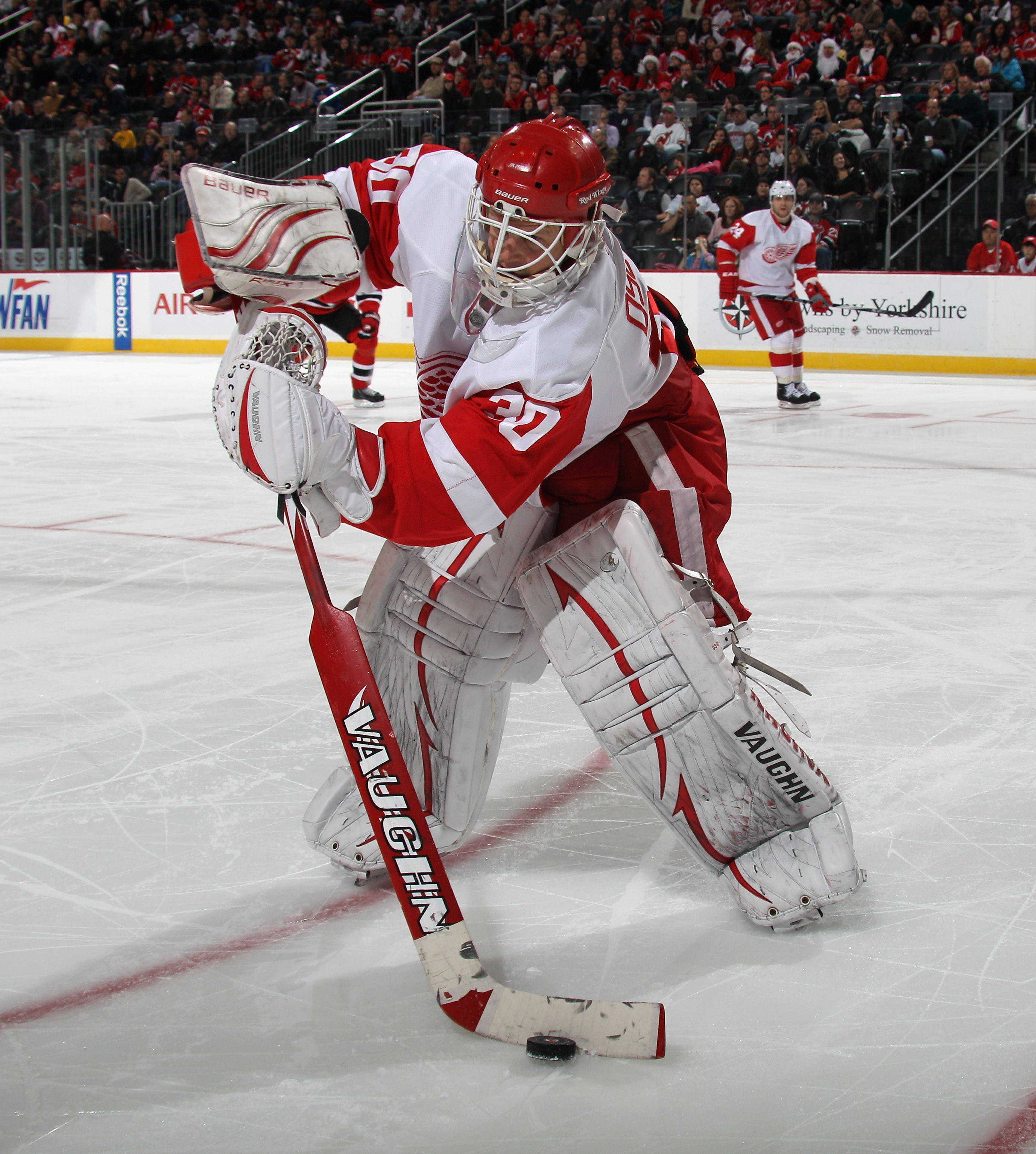 NEWARK, NJ - DECEMBER 11:  Chris Osgood #30 of the Detroit Red Wings tends net against the New Jersey Devils at the Prudential Center on December 11, 2010 in Newark, New Jersey. The Red Wings defeated the the Devils 4-1.  (Photo by Bruce Bennett/Getty Ima