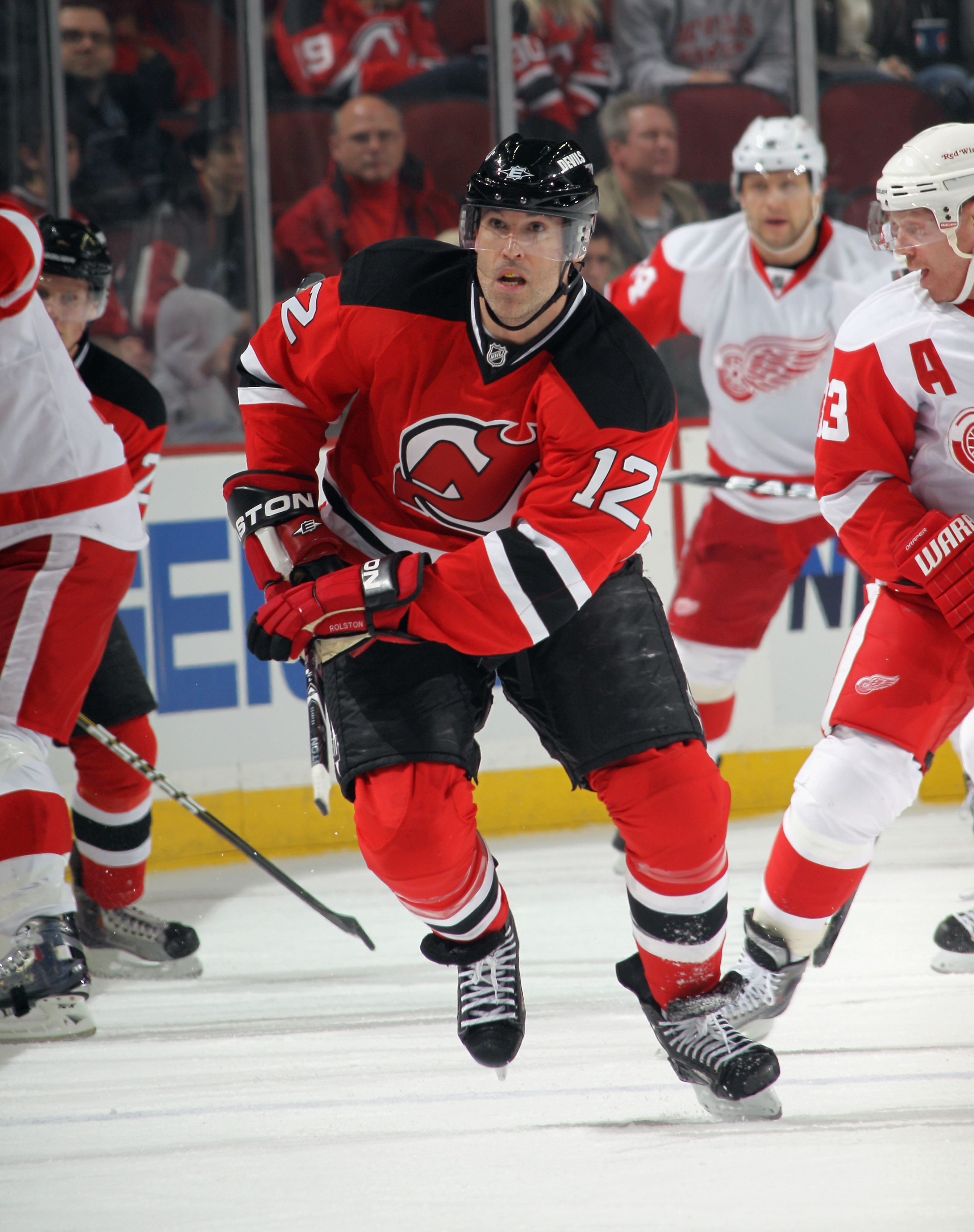 NEWARK, NJ - DECEMBER 11: Brian Rolston #12 of the New Jersey Devils skates against the Detroit Red Wings at the Prudential Center on December 11, 2010 in Newark, New Jersey. The Red Wings defeated the the Devils 4-1.  (Photo by Bruce Bennett/Getty Images