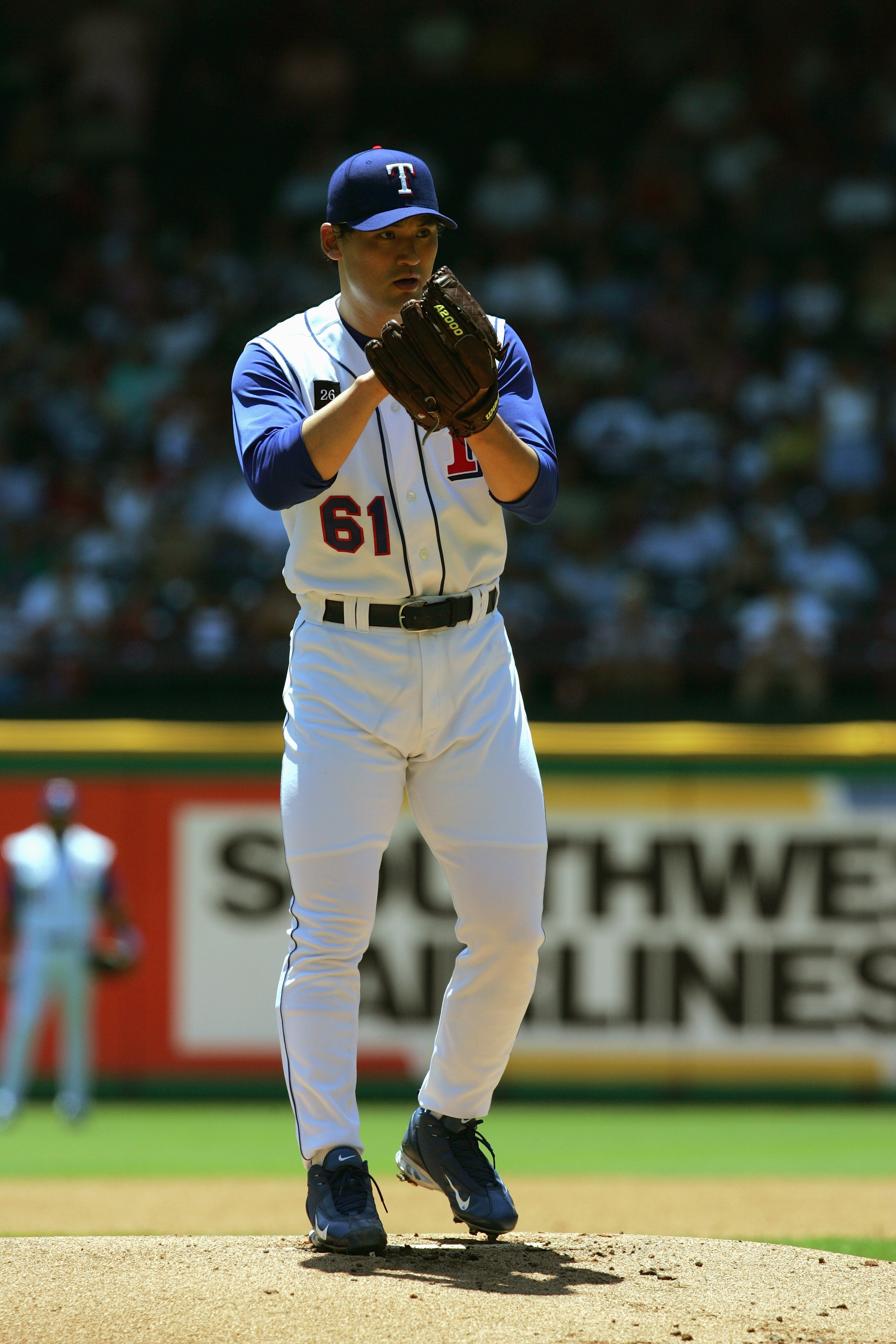 ARLINGTON, TX - JULY 24:  Chan Ho Park #21 of the Texas Rangers pitches during the game with the Oakland Atheltics on July 24, 2005 at Ameriquest Field in Arlington in Arlington, Texas.  The Athletics defeated the Rangers 8-3.  (Photo by Ronald Martinez/G