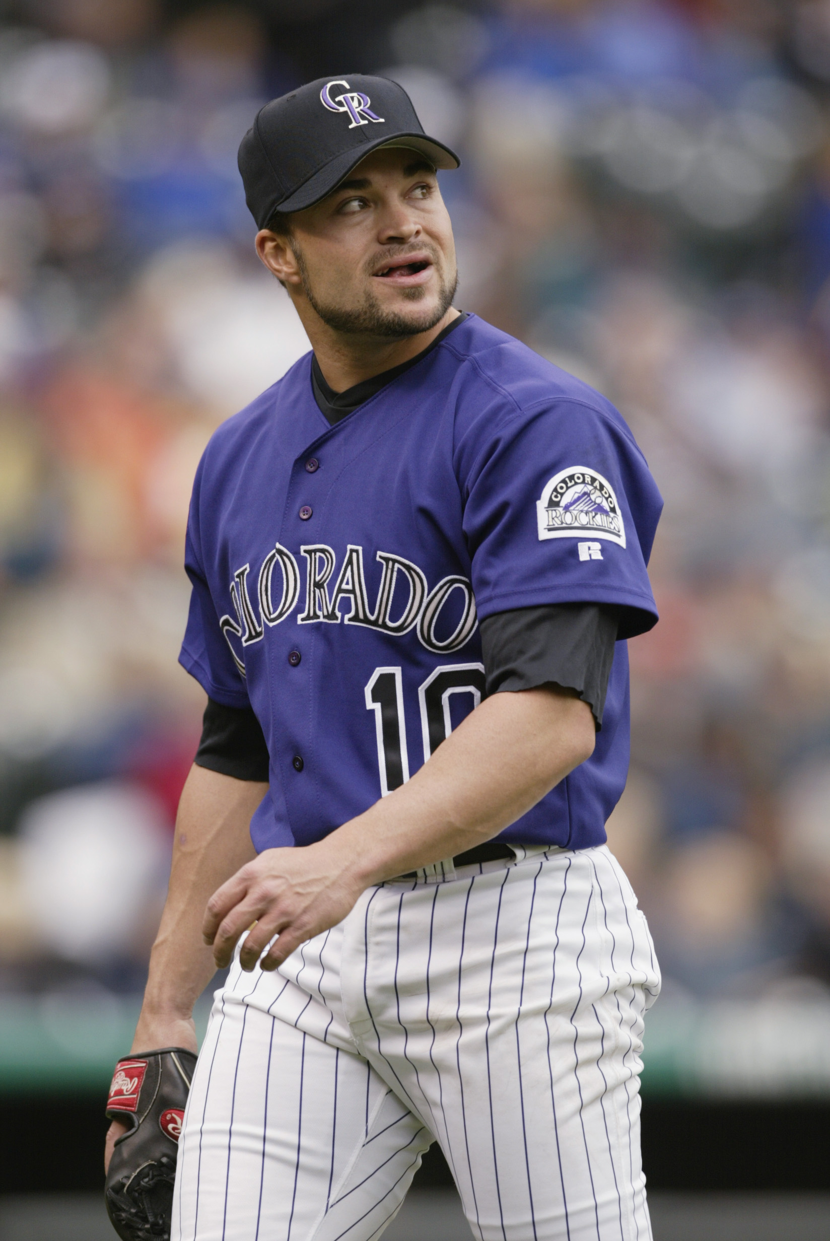 DENVER - May 16 2002:   Starting pitcher Mike Hampton #10 of the Colorado Rockies smiles as he walks off the field after retiring the Florida Marlins in the third inning at Coors Field in Denver, Colorado, on May 16, 2002.   Hampton got the 10-3 win on th