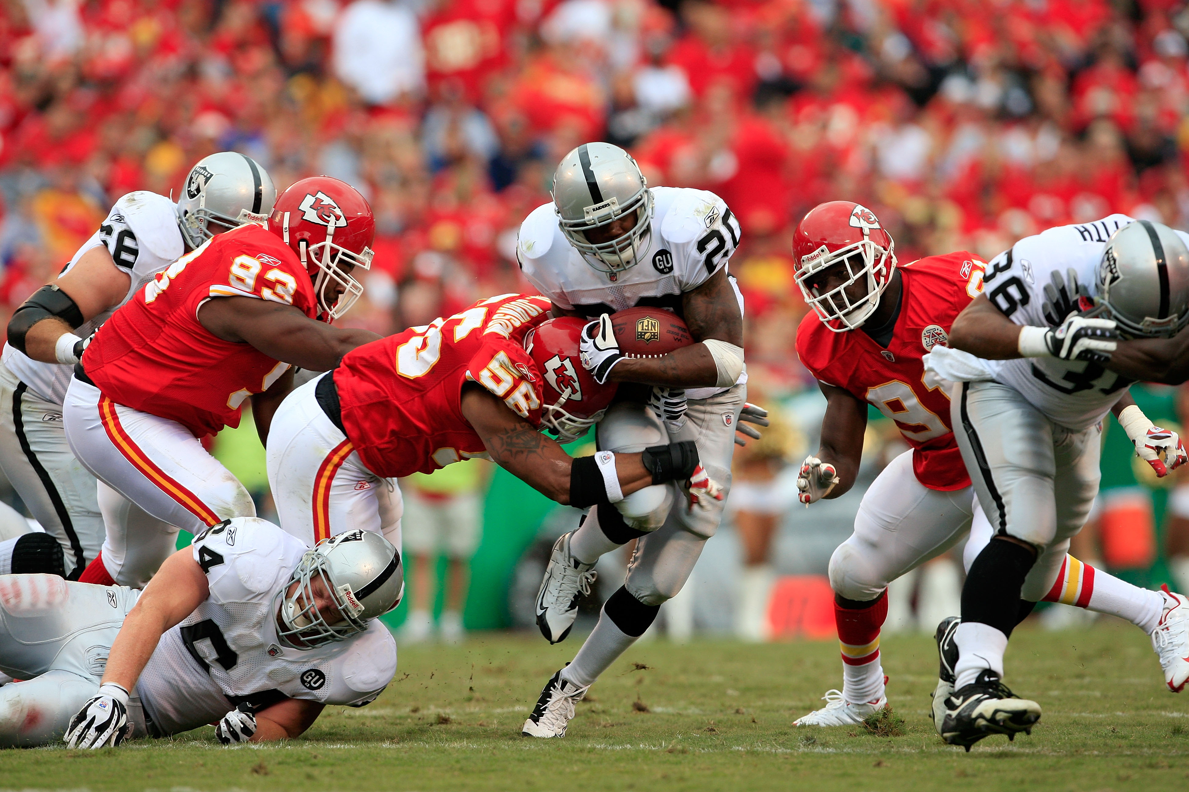 KANSAS CITY, MO - SEPTEMBER 14:  Darren McFadden #20 of the Oakland Raiders carries the ball as Derrick Johnson #56 of the Kansas City Chiefs defends during the first half fo the game on September 14, 2008 at Arrowhead Stadium in Kansas City, Missouri.  (