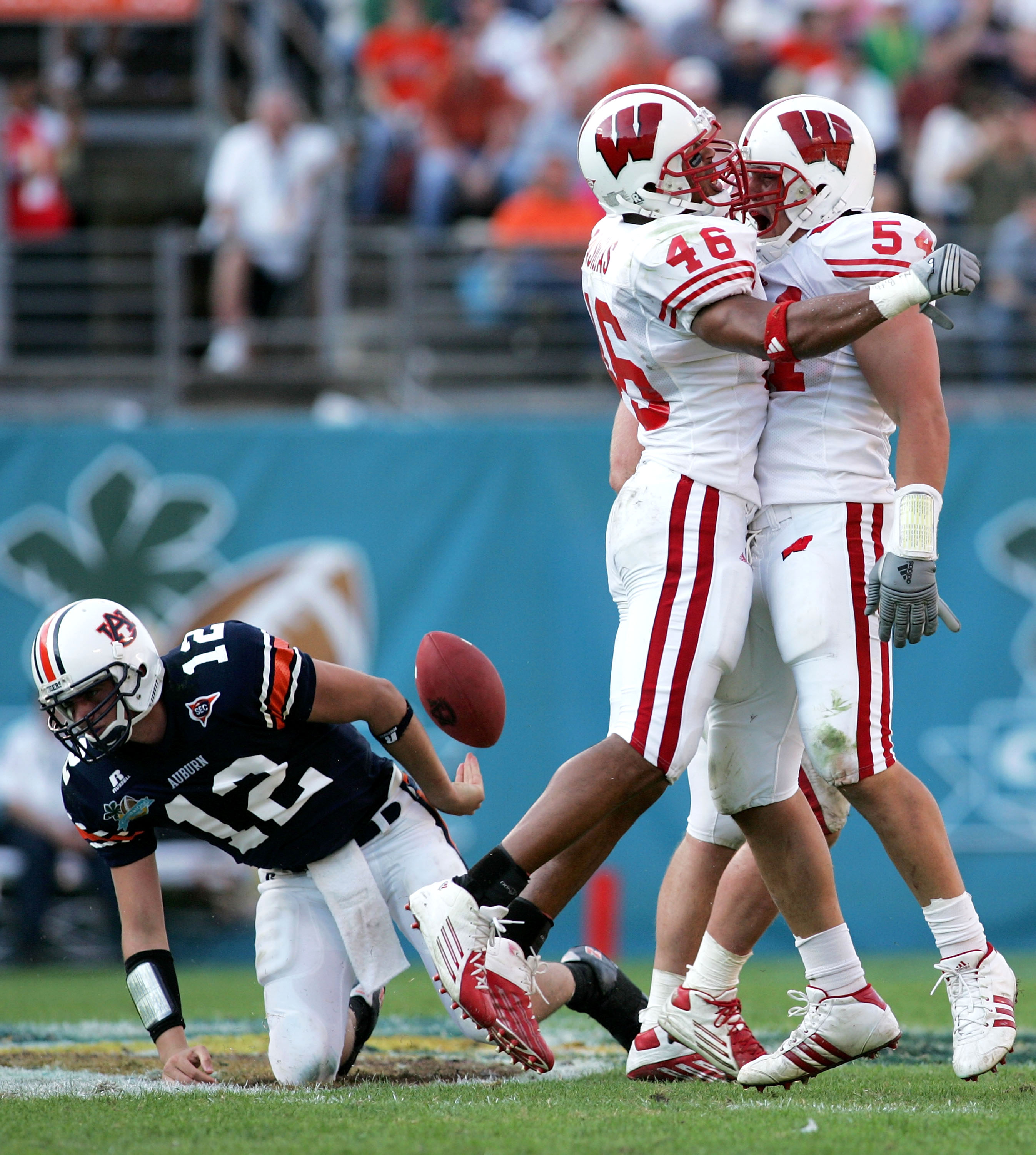 ORLANDO, FL - JANUARY 2:  Defenders Seth Frankenthal #48 and Mike Newkirk #54 of the Wisconsin Badgers celebrate after sacking quarterback Brandon Cox #12 of the Auburn Tigers during the Capital One Bowl on January 2, 2006 at the Florida Citrus Bowl in Or