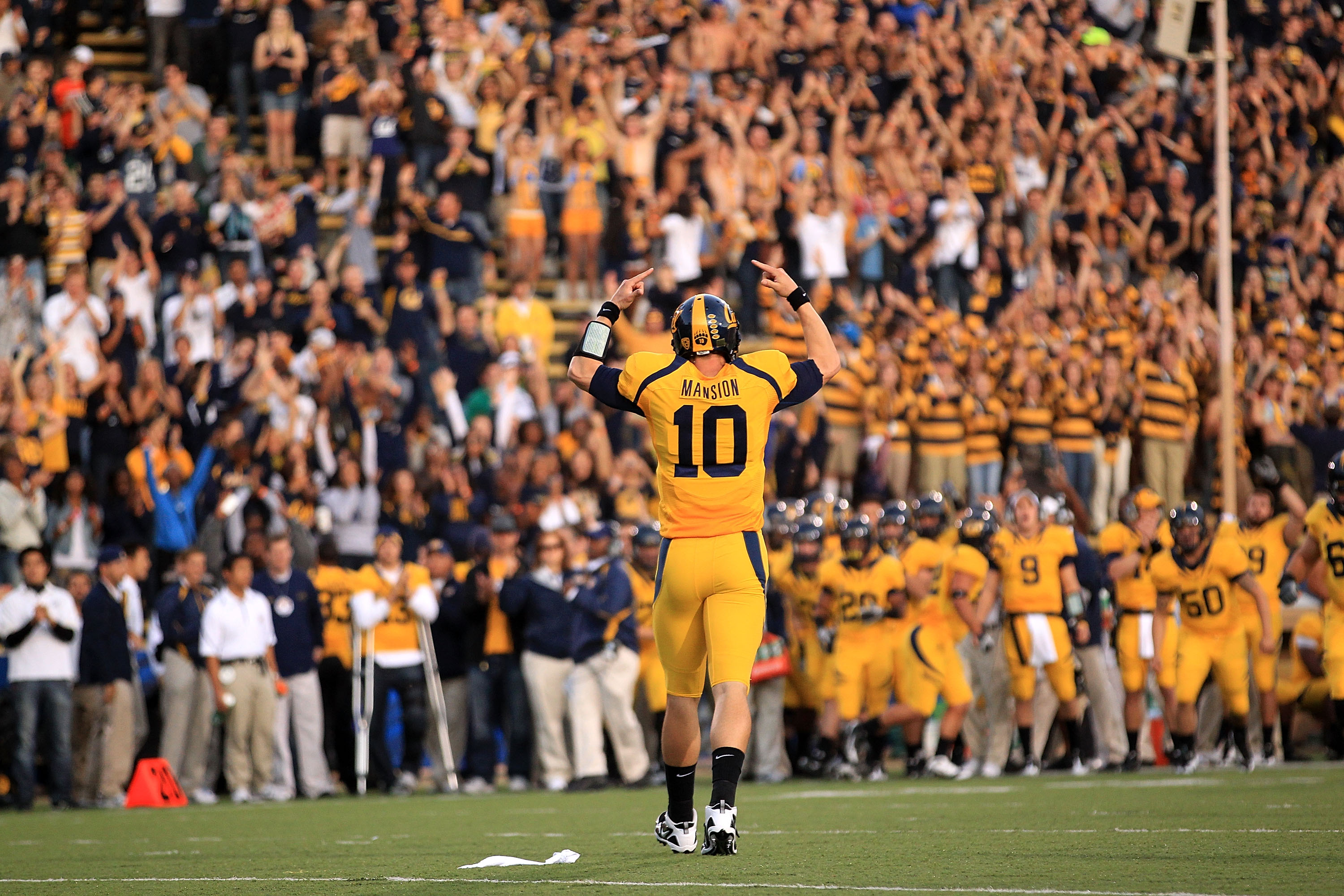 BERKELEY, CA - NOVEMBER 13:  Brock Mansion #10 of the California Golden Bears celebrates after they scored a touchdown against the Oregon Ducks at California Memorial Stadium on November 13, 2010 in Berkeley, California.  (Photo by Ezra Shaw/Getty Images)