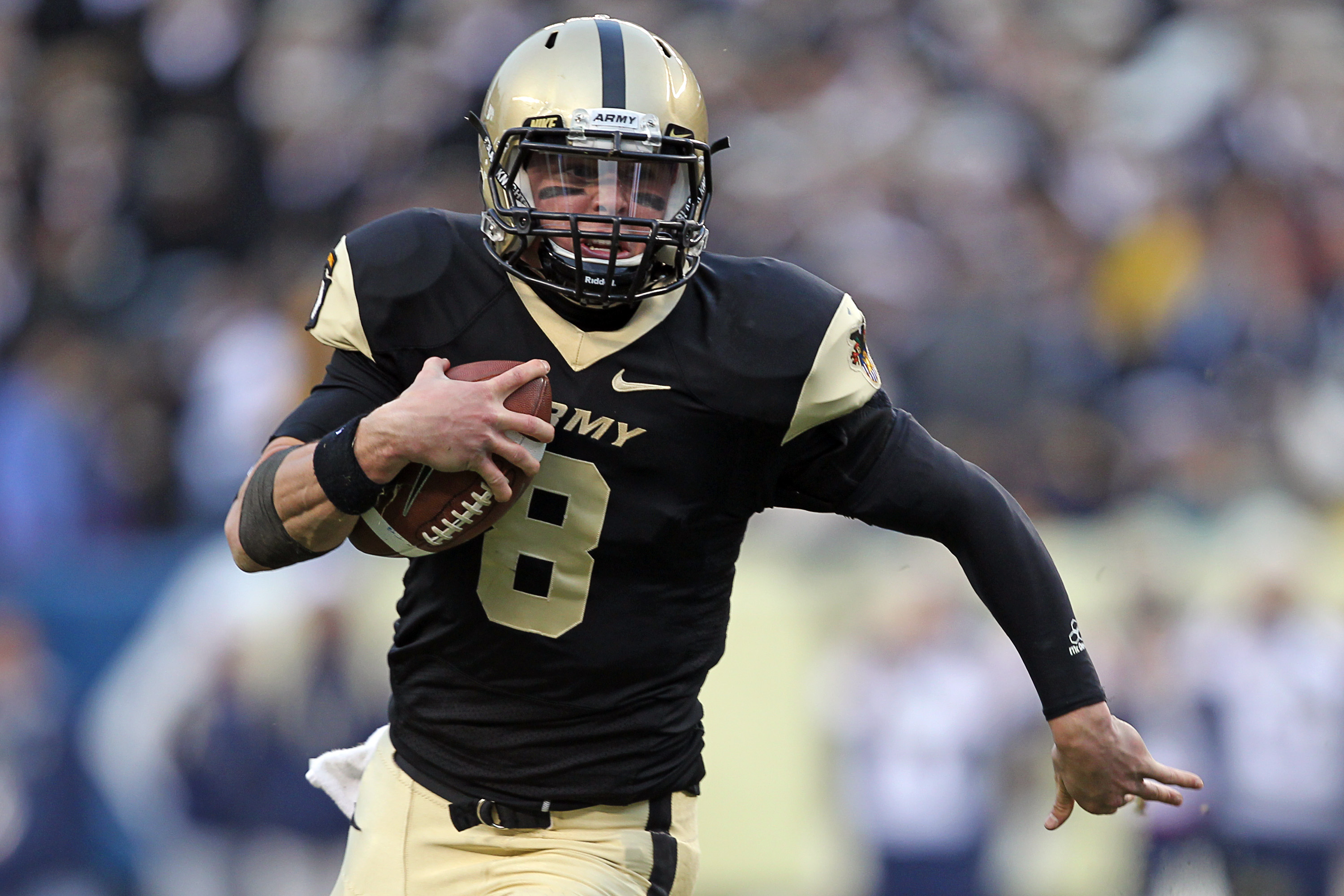 PHILADELPHIA - DECEMBER 11: Quarterback Trent Steelman #8 of the Army Black Knights runs with the ball during the game against the Navy Midshipmen on December 11, 2010 at Lincoln Financial Field in Philadelphia, Pennsylvania. The Midshipmen won 31-17. (Ph