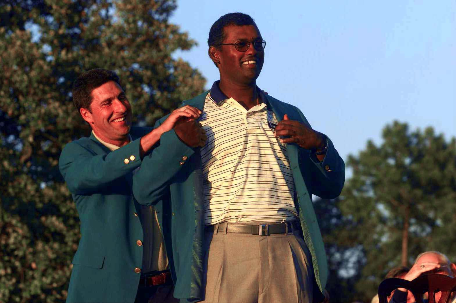 9 Apr 2000:  Vijay Singh of Fiji recives the green jacket from last years winner Jose Maria Olazabal of Spain during the final round of the Masters at Augusta National Golf Club, Georgia. Mandatory Credit: ANDREW REDINGTON/ALLSPORT